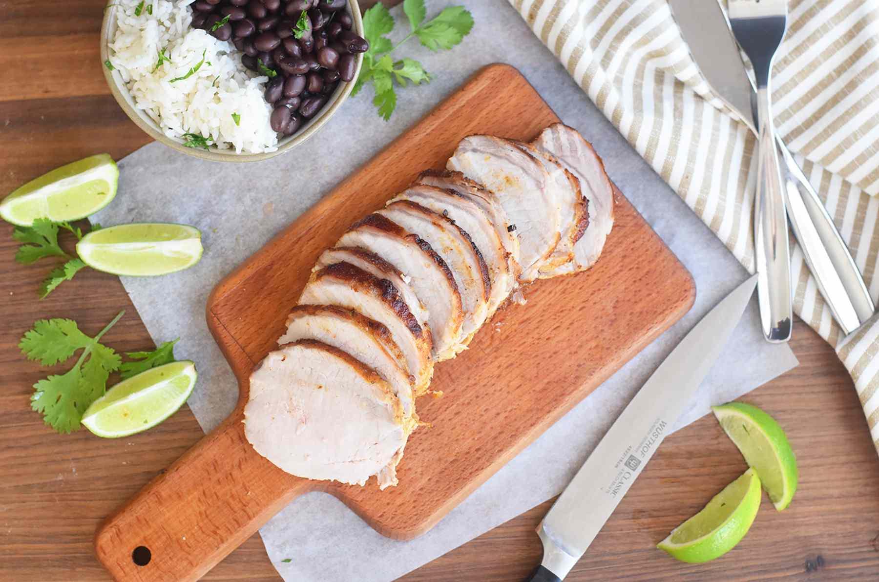Cuban roast pork sliced on a cutting board
