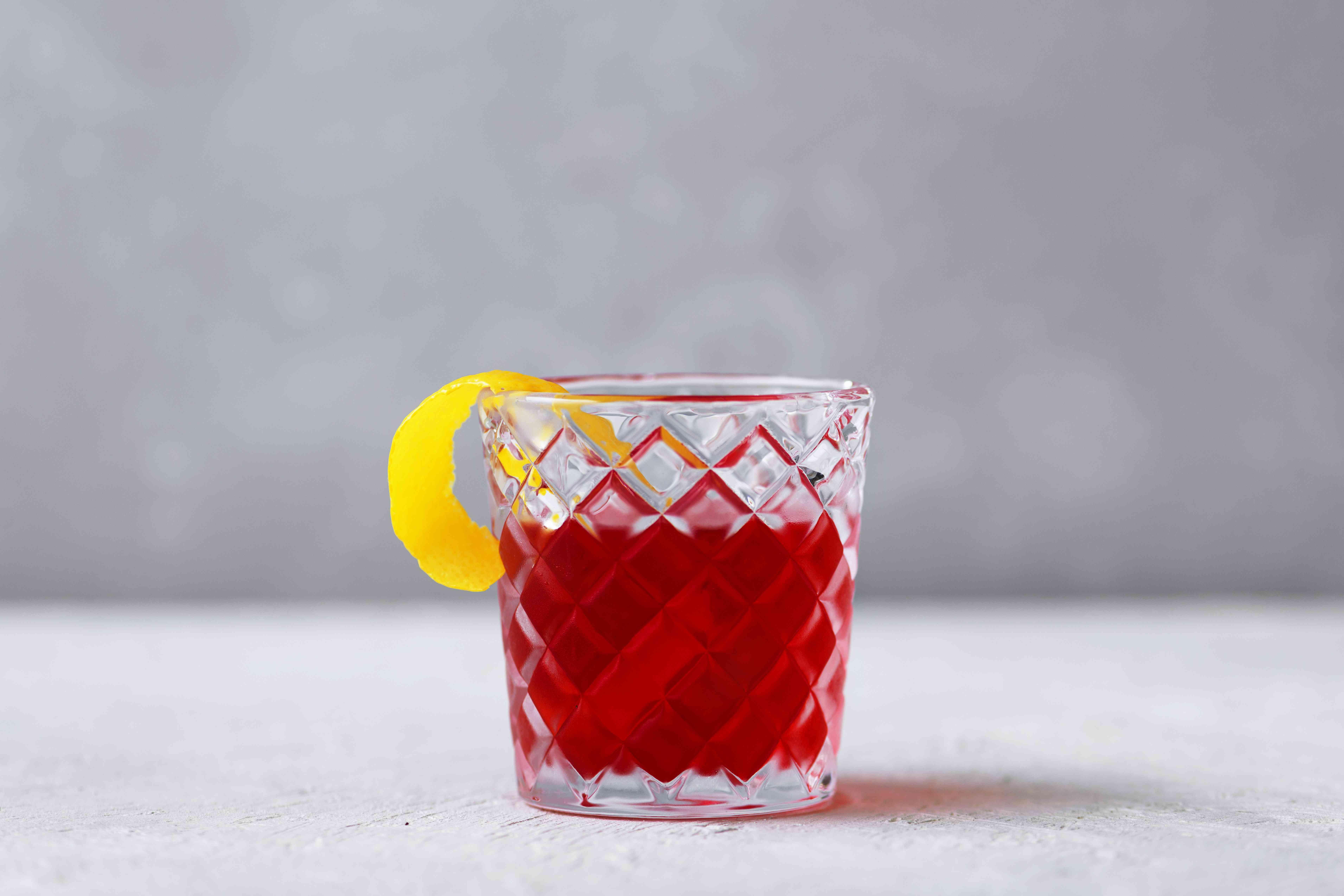 Campari Cocktail garnished with a lemon twist