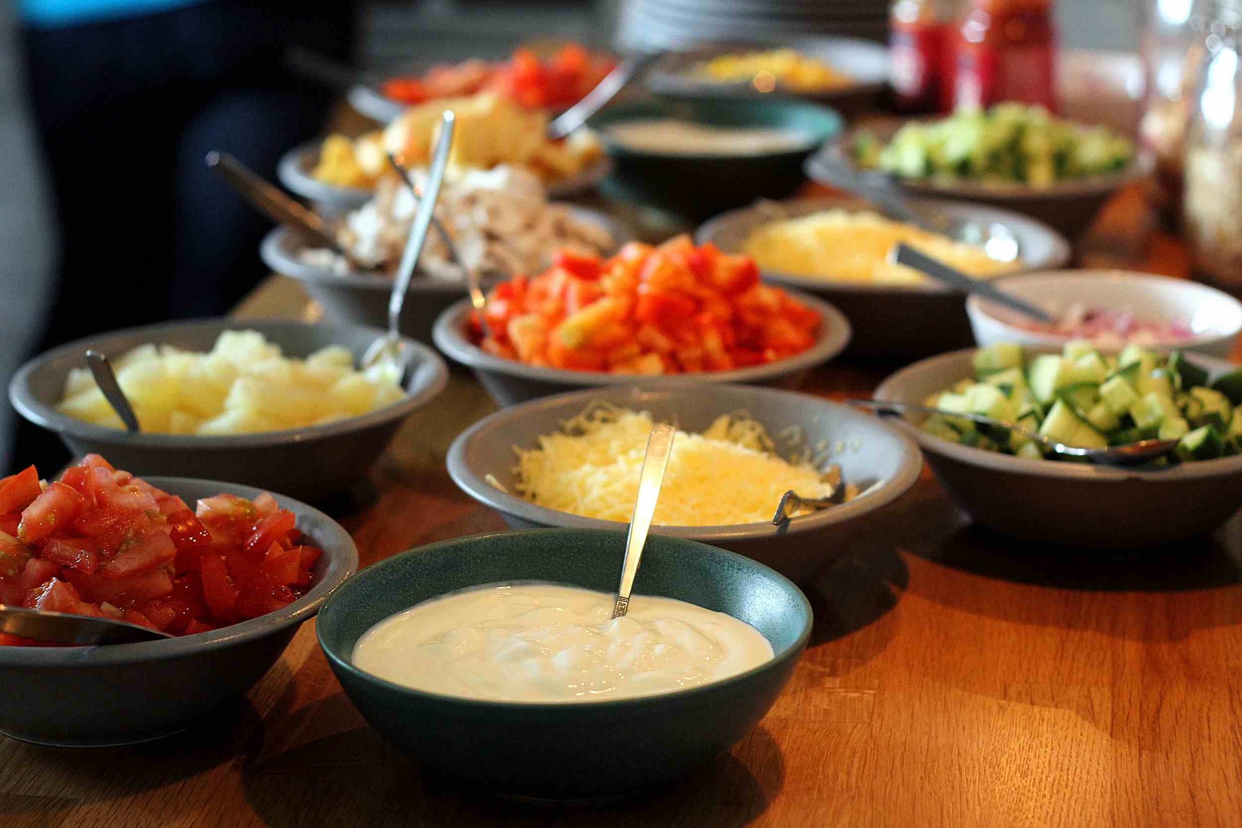 Mexican garnishes laid out across table