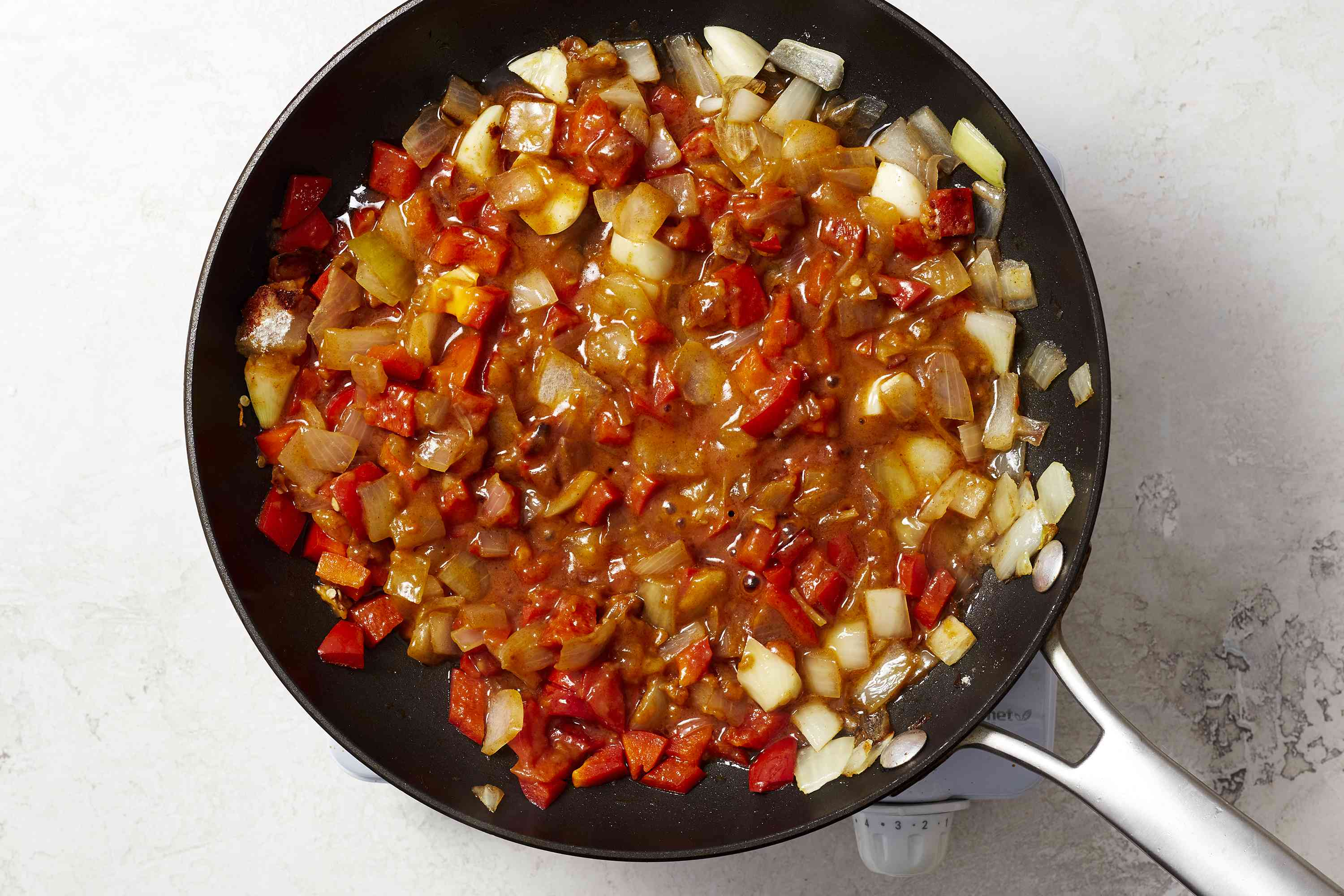 add sauce to the vegetable mixture in the pan