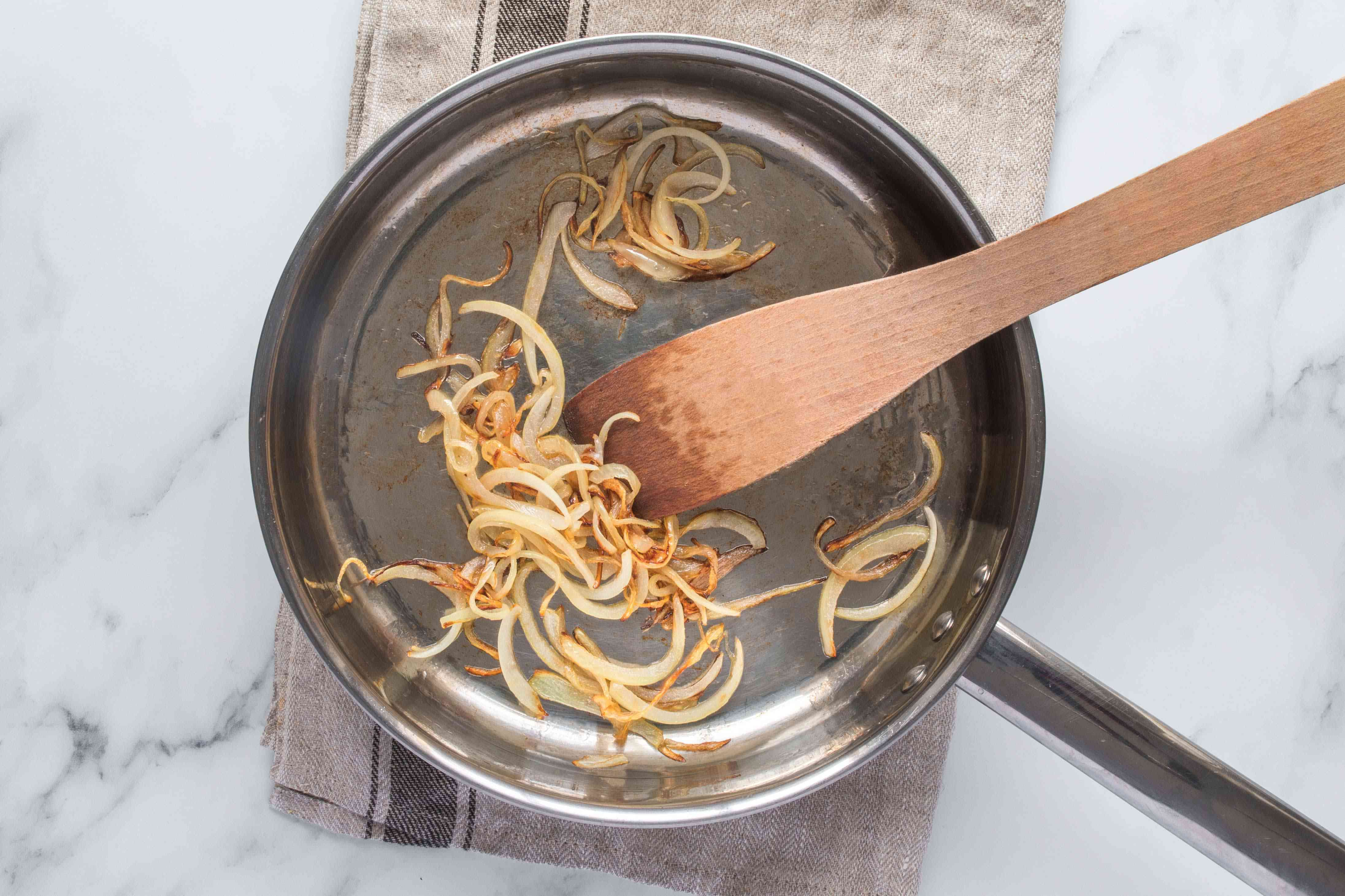 Onion cooking in a pan