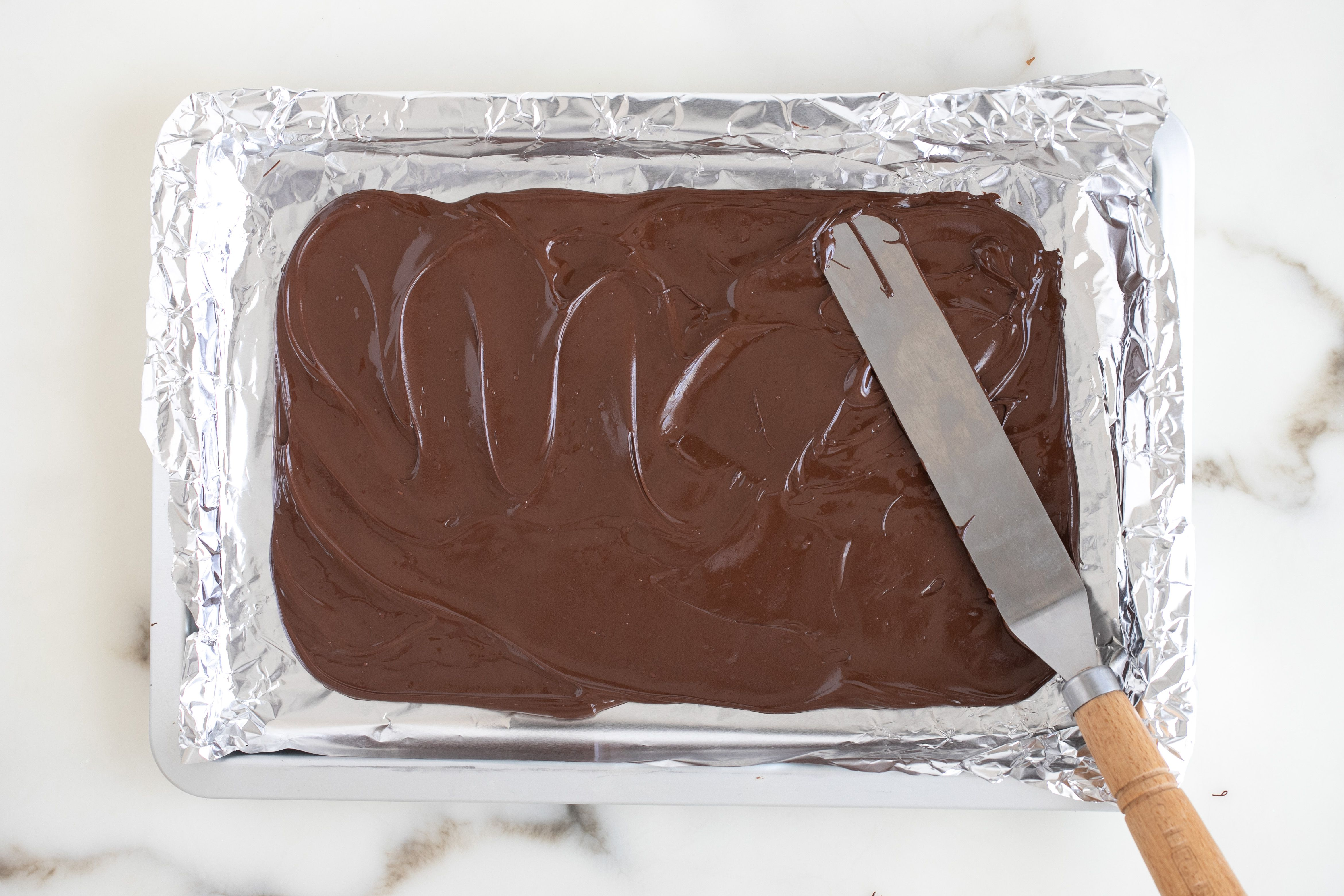Pour chocolate onto cookie sheet