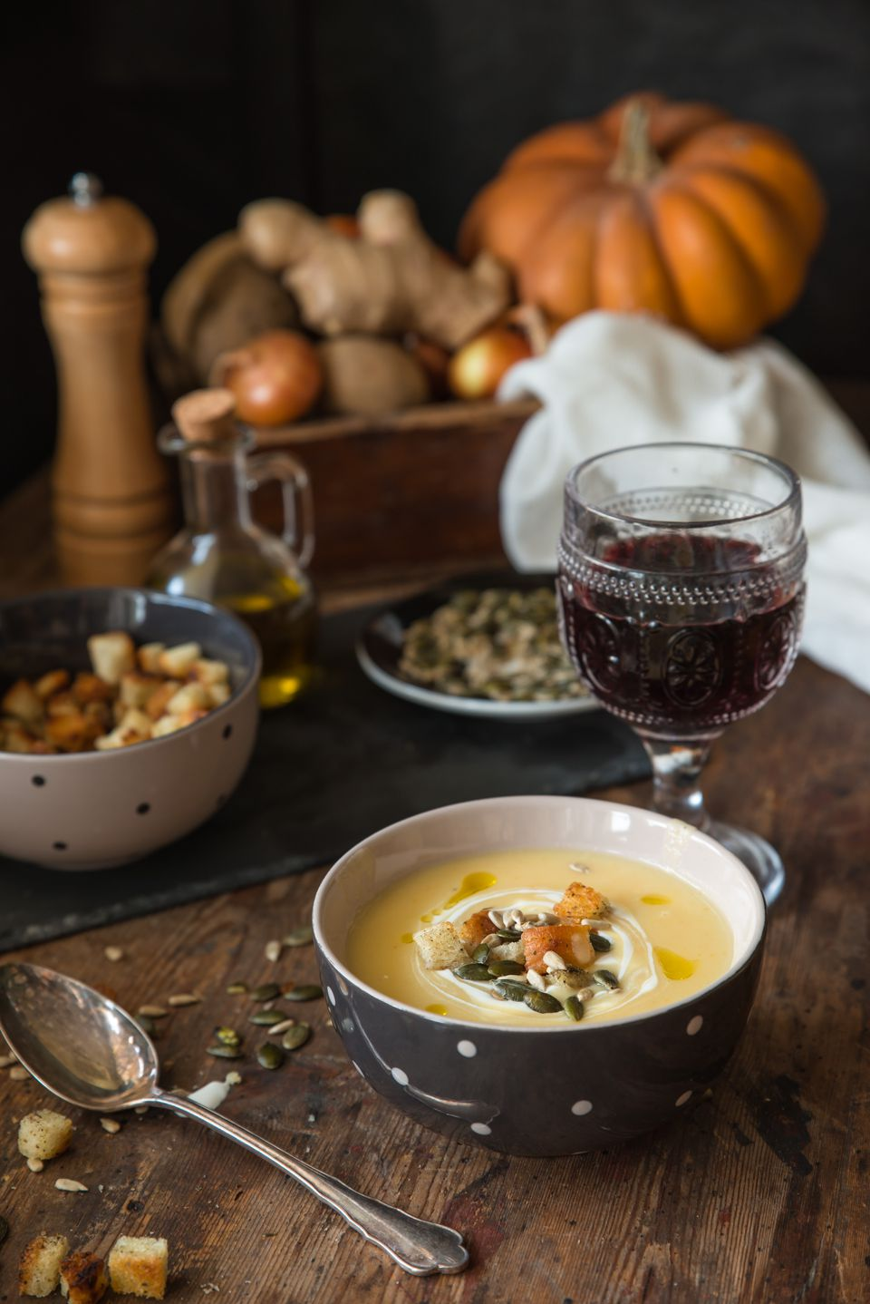 Potato soup with cream and glass of red wine