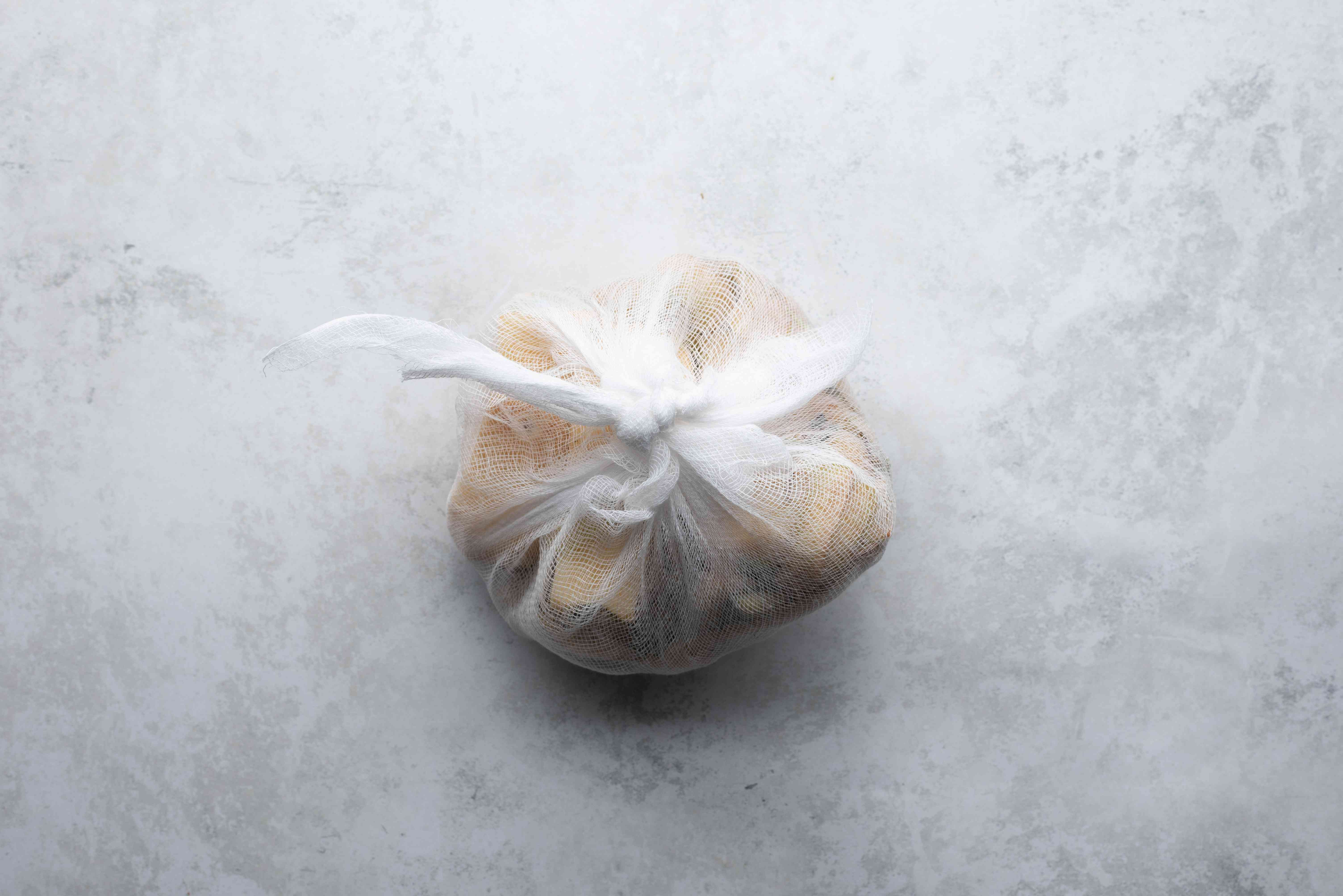 quince in a cheesecloth
