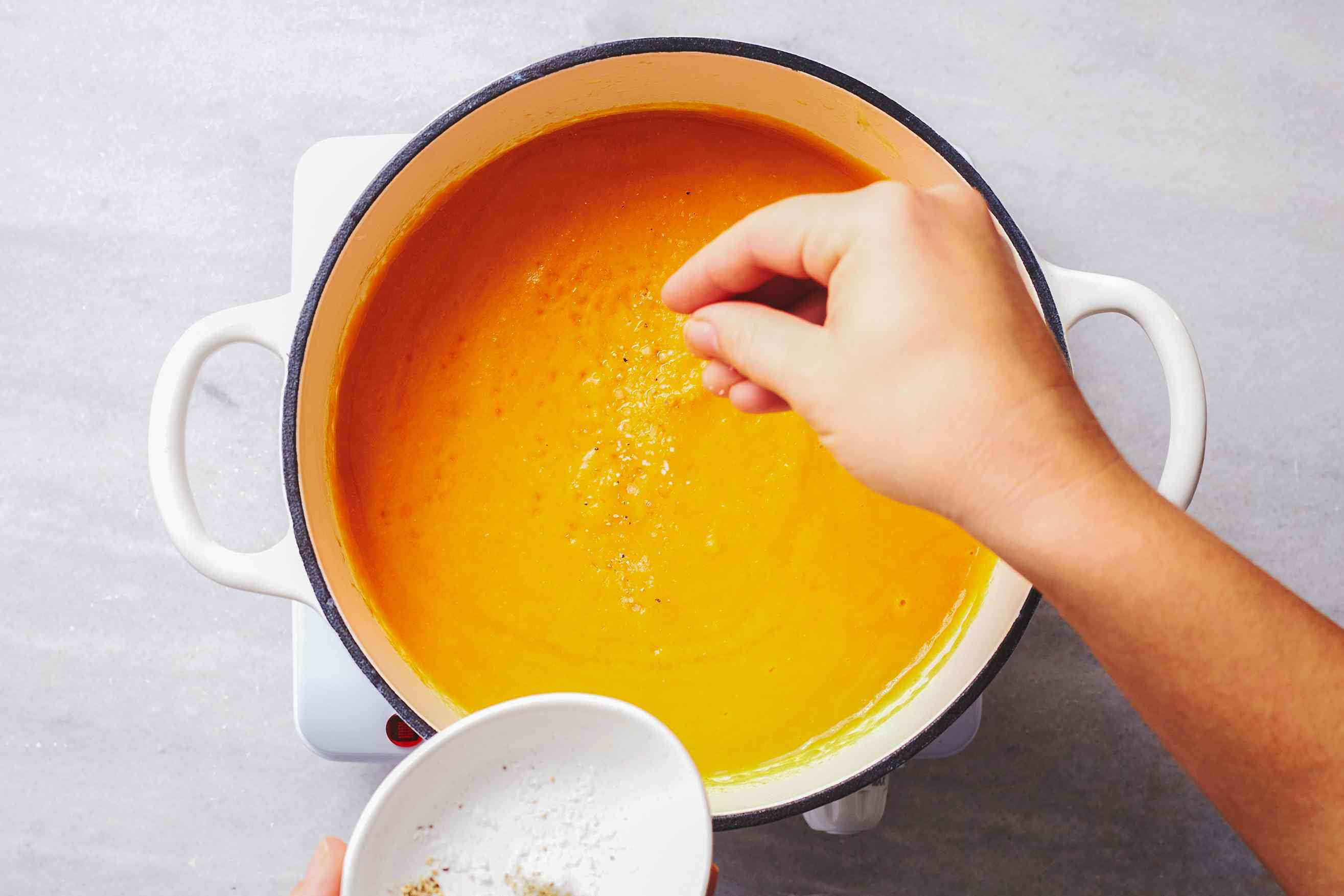 season the Purée of Carrot Soup in the pot