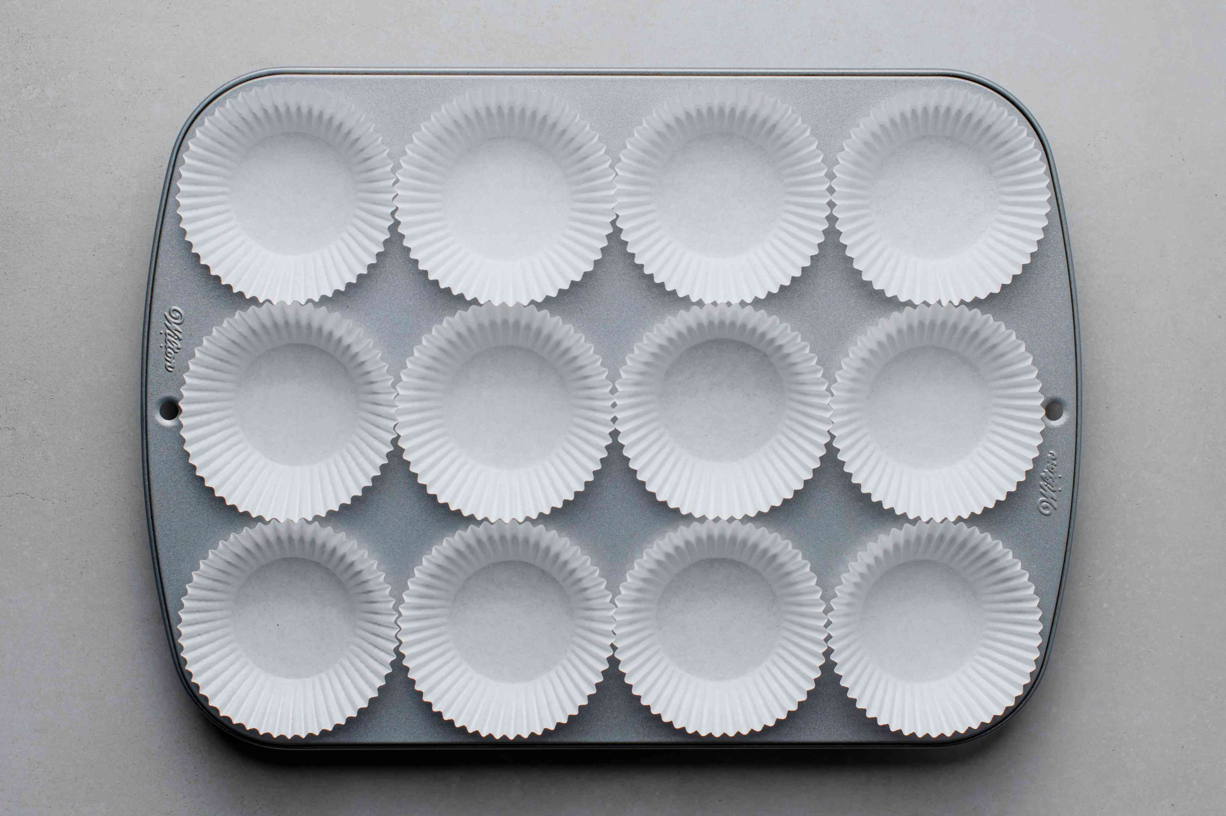 muffin tin with paper baking cups