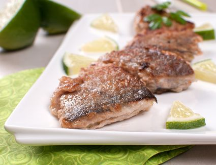 Fried white fish pieces with lime