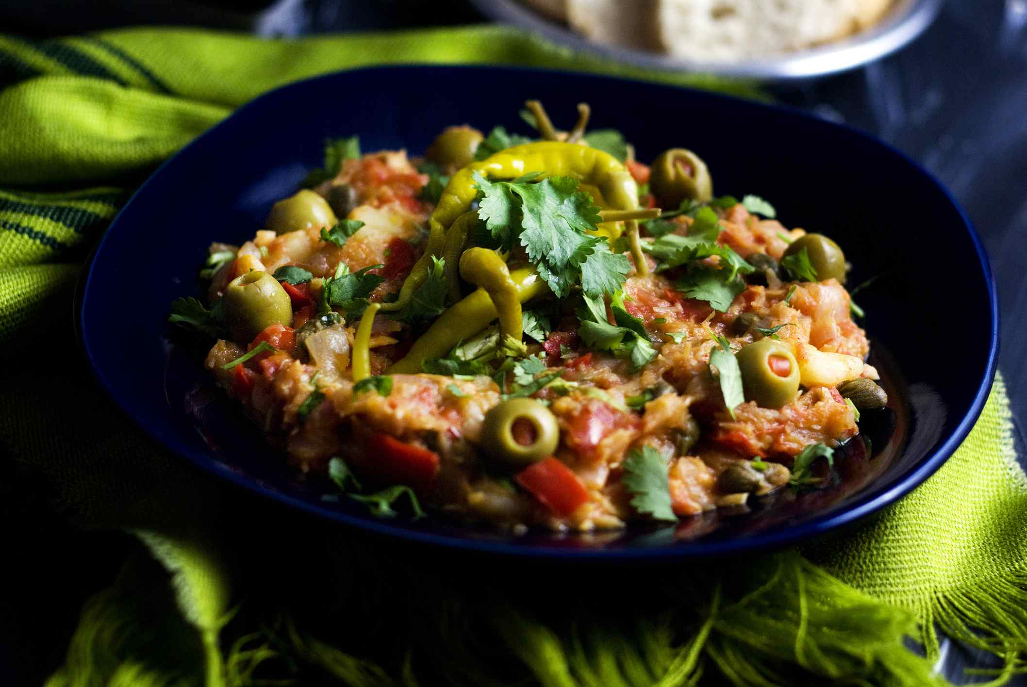 Bacalao with onions, peppers, and olives