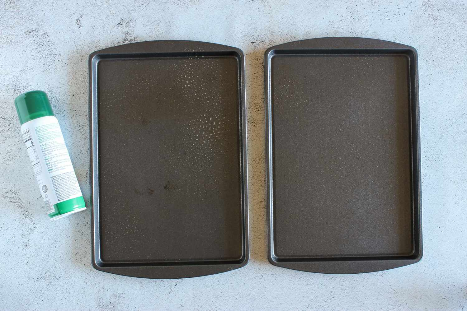 Two rimmed baking sheets coated with nonstick spray