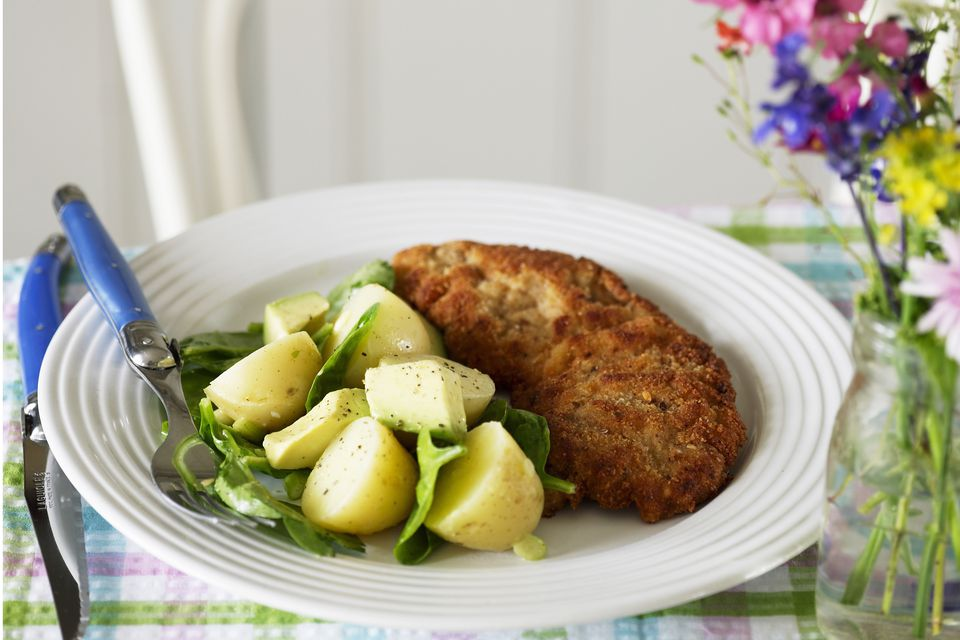 Breaded chicken and squash on plate.