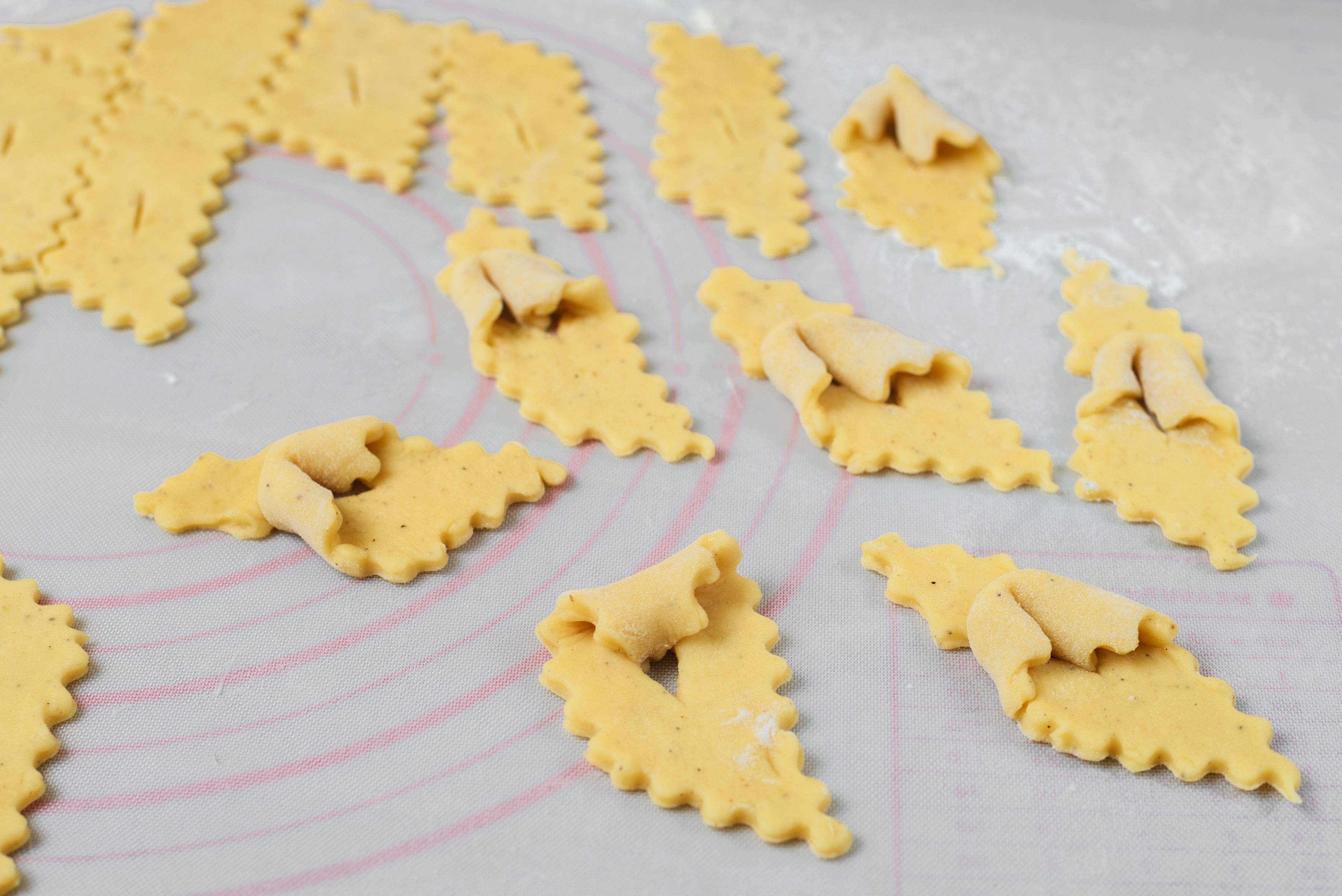 Corner of each diamond folded into slit for Poor Man Cookies