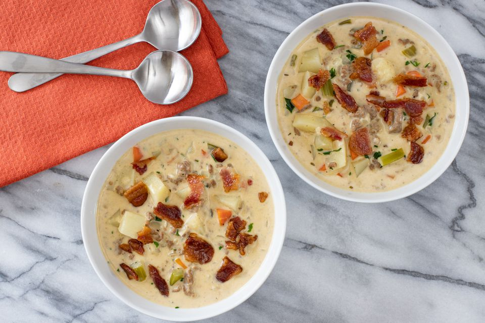 bowls of cheeseburger soup with bacon