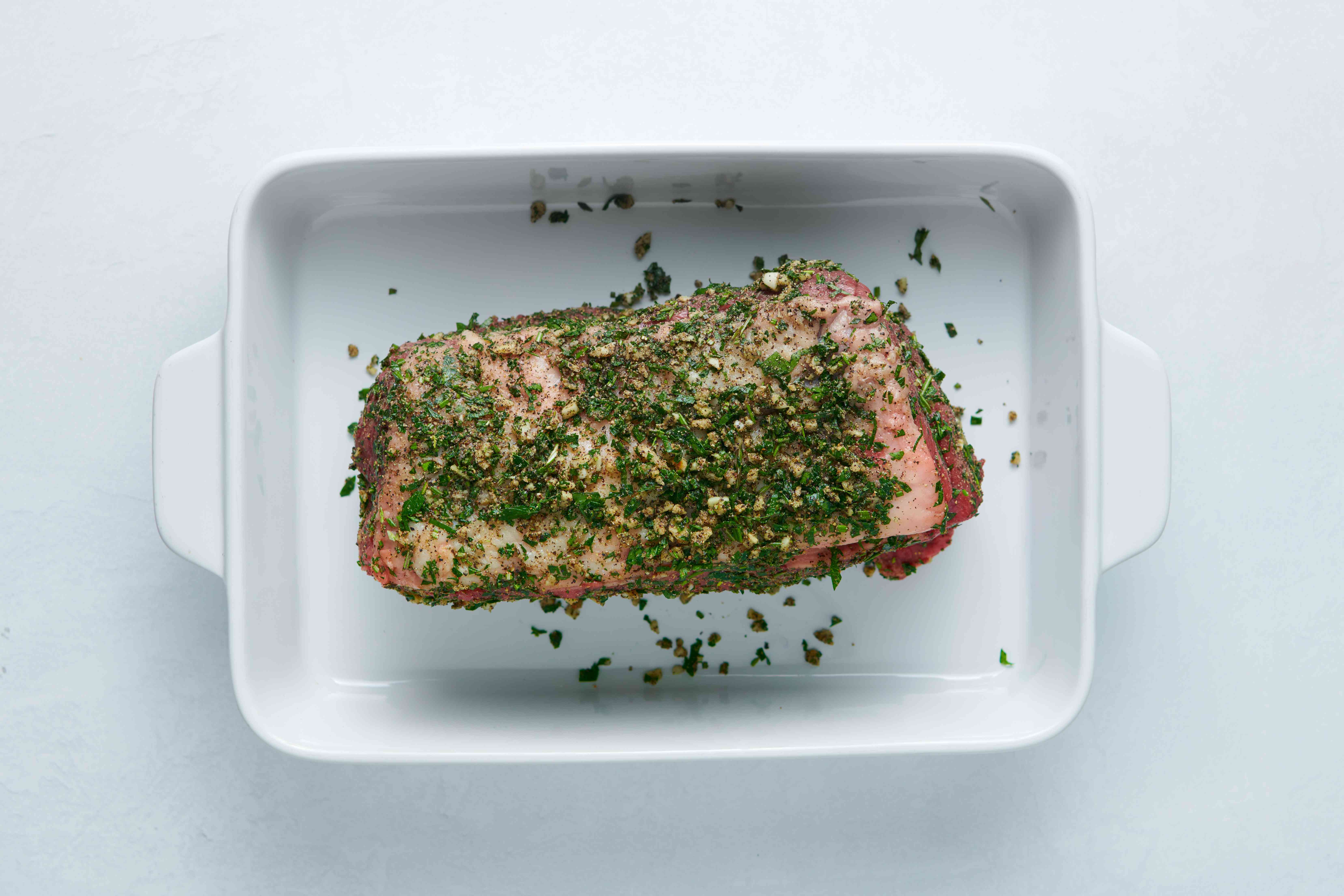 roast rubbed with seasoning, in a baking pan