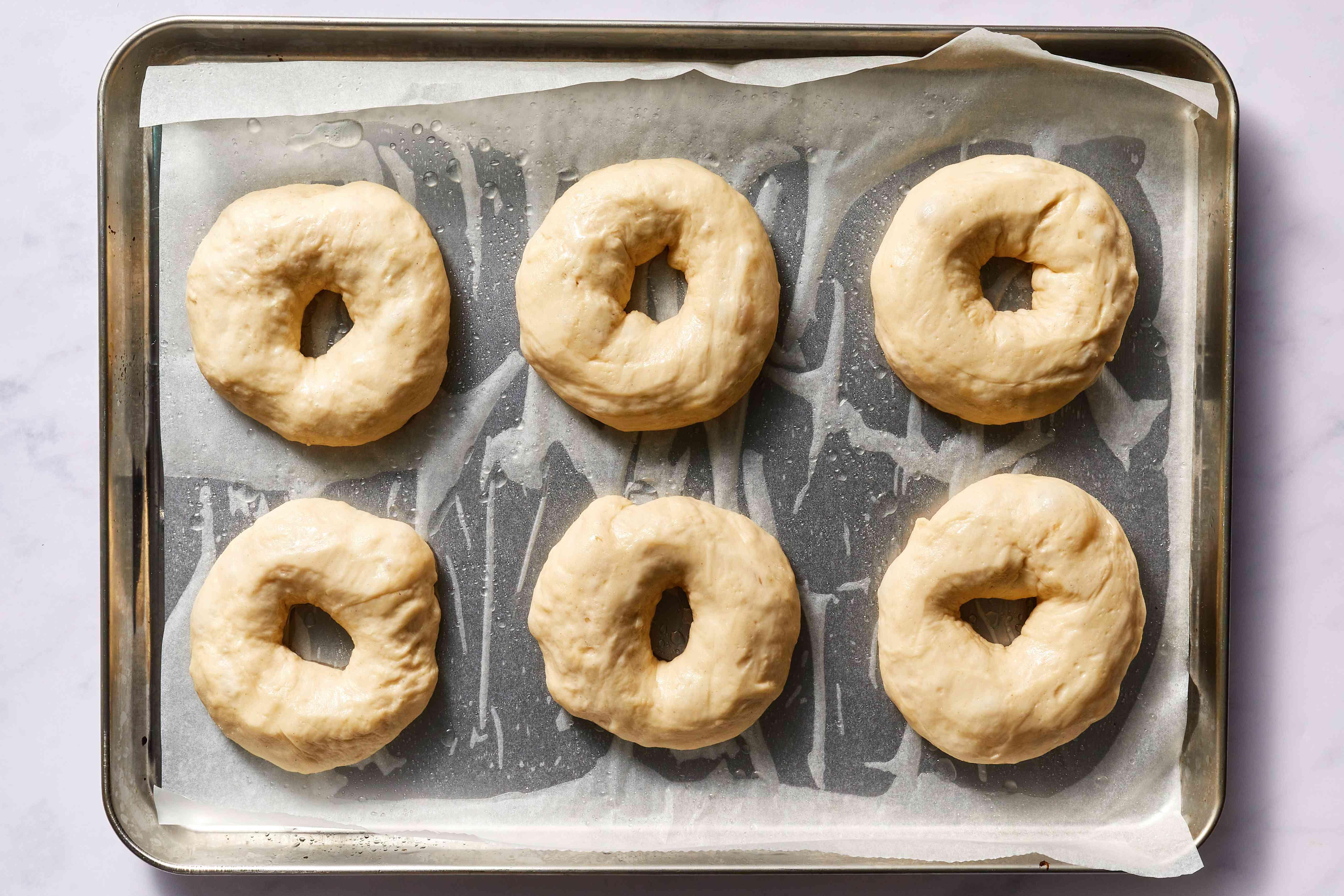 formed bagels on a baking sheet