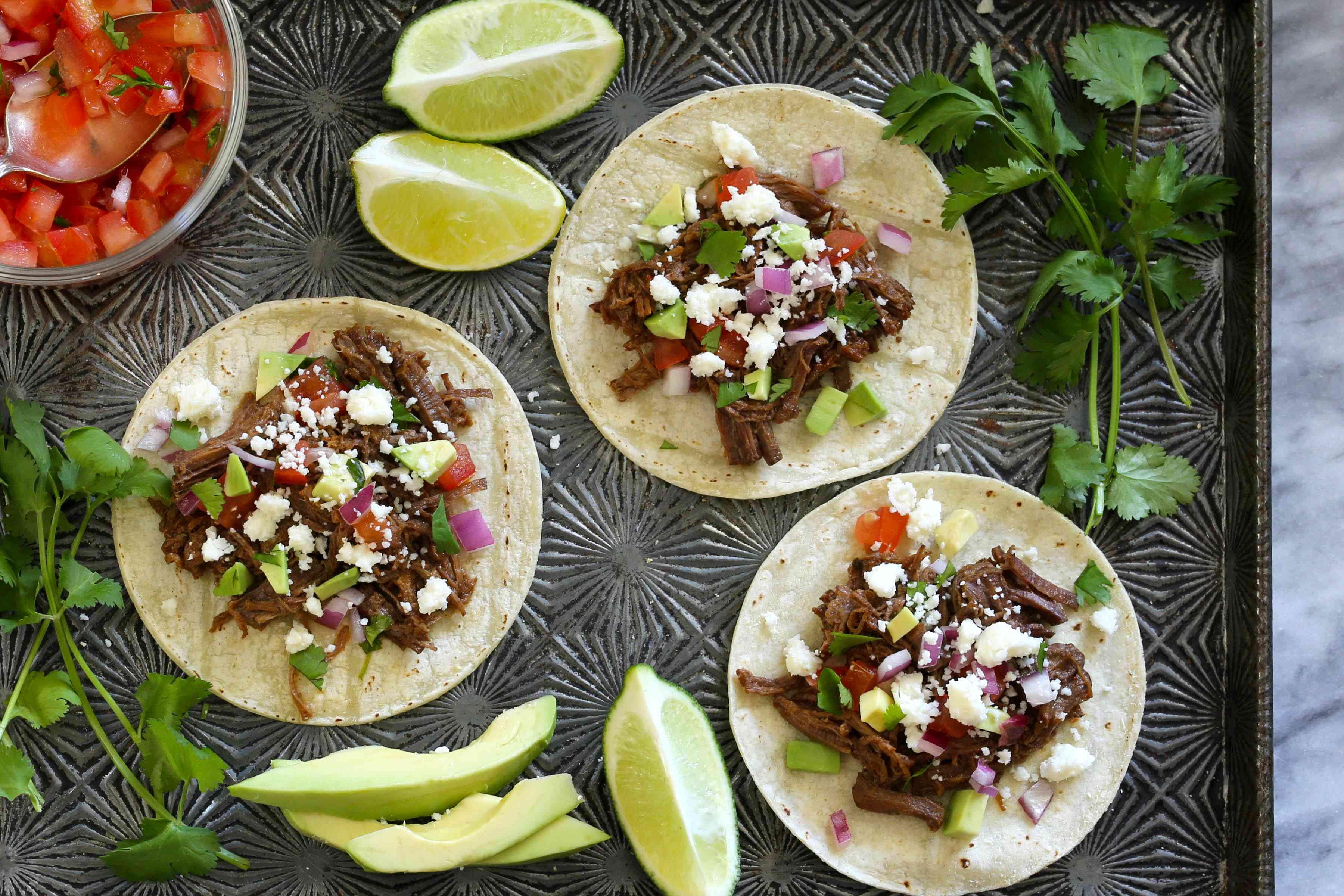 Barbacoa tacos with fixings.