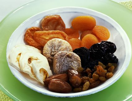 Dried apricot, plums, apples, pears, figs, raisins and dates in bowl