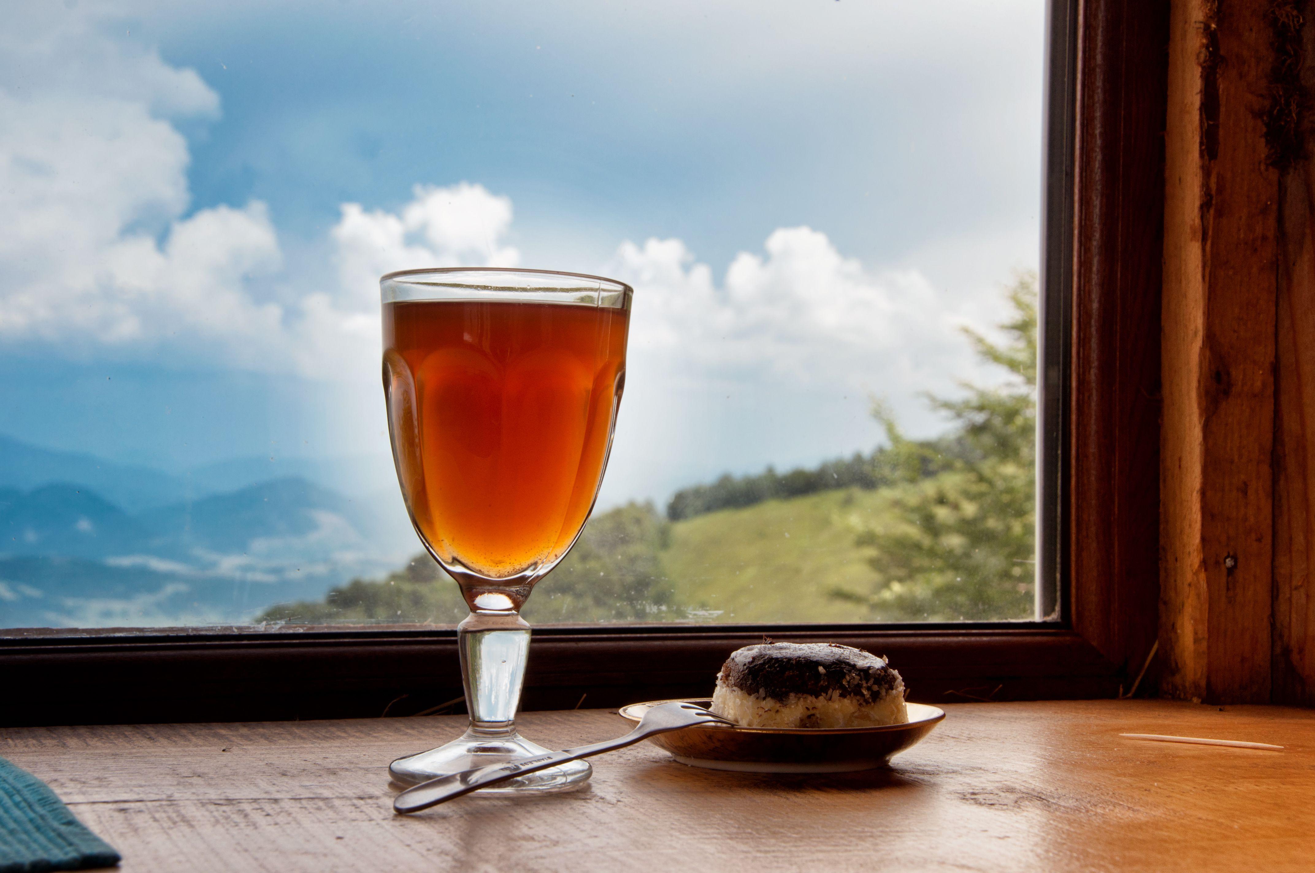 Hot Sbiten drink with cake in Carpatians kolyba
