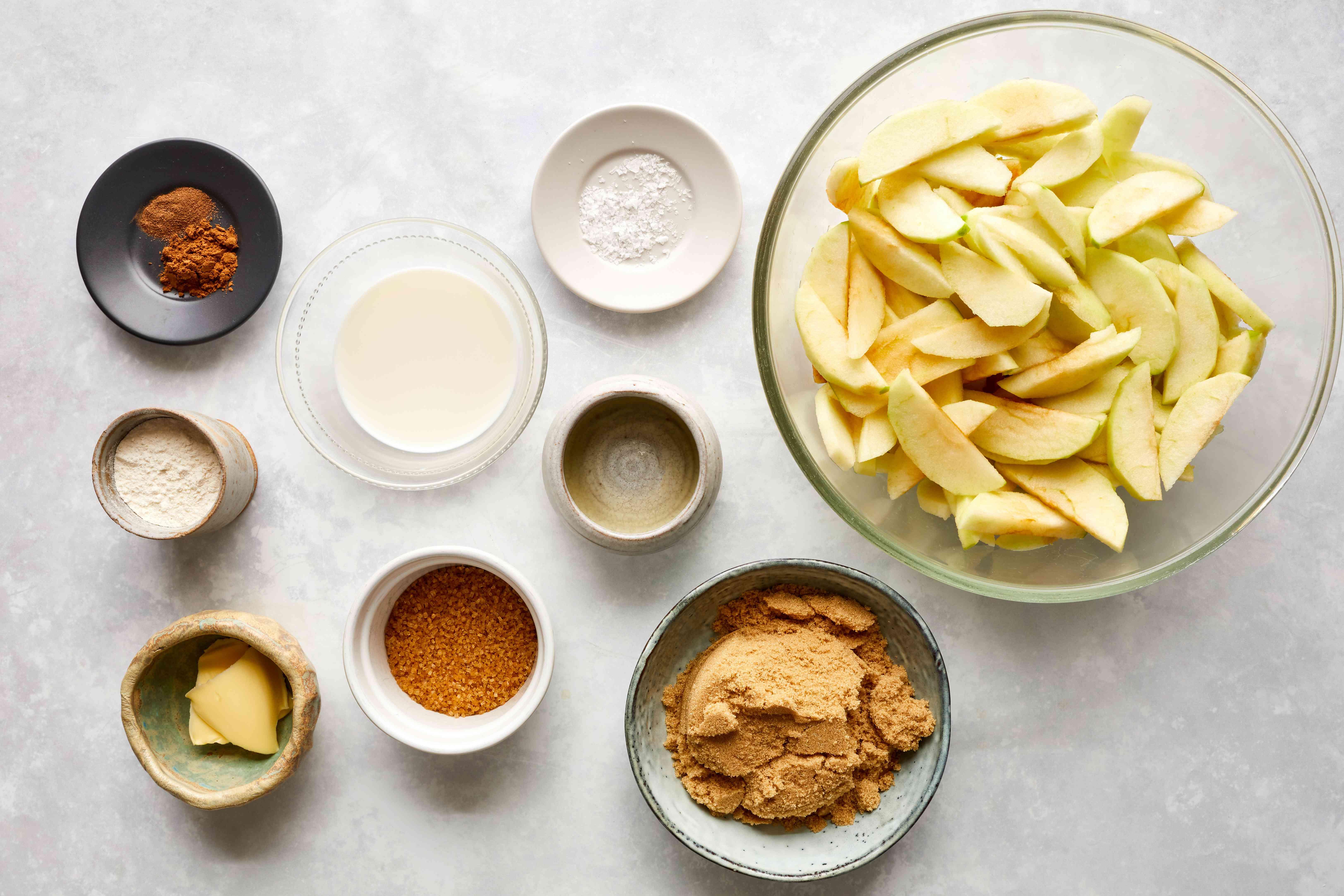 Granny Smith Apple Pie filling ingredients, apple slices, sugar, salt, butter, milk, flour, lemon juice, nutmeg, cinnamon,
