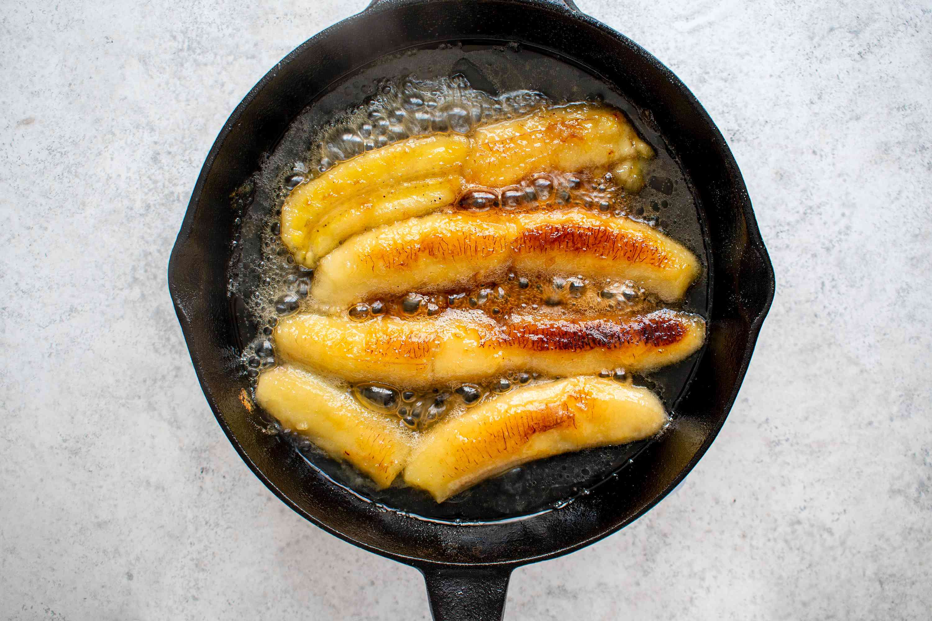 cook the bananas in the pan with the sugar and rum