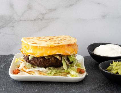 Quesadilla burger with extra cheese in the top bun