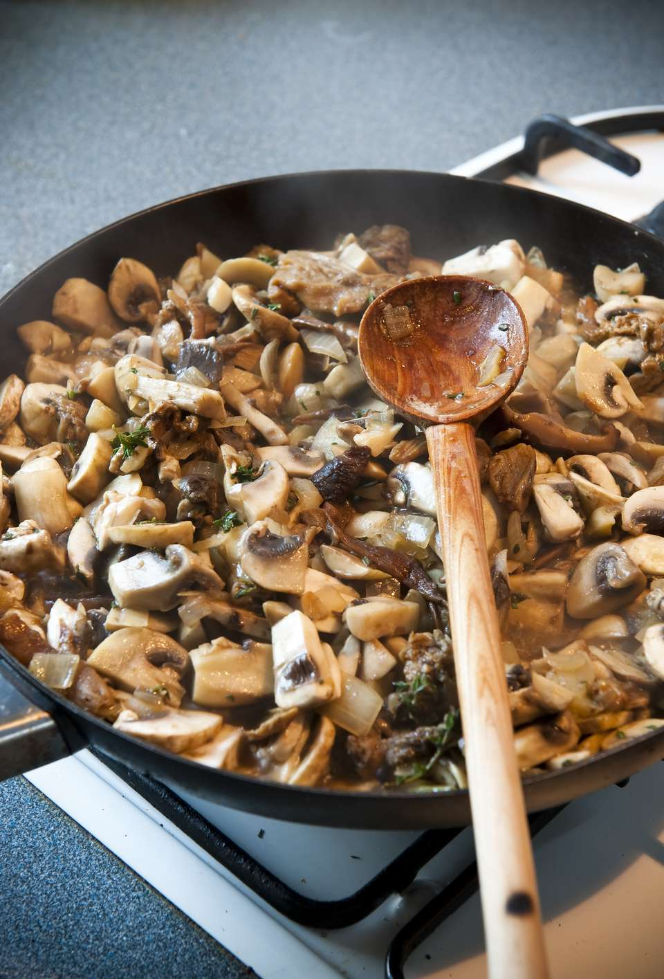 Mushroom frying pan gas stove wooden spoon