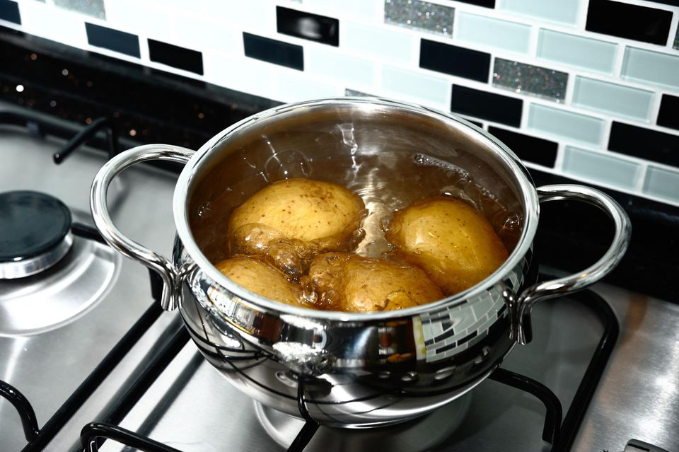 Boiling potatoes in a pot