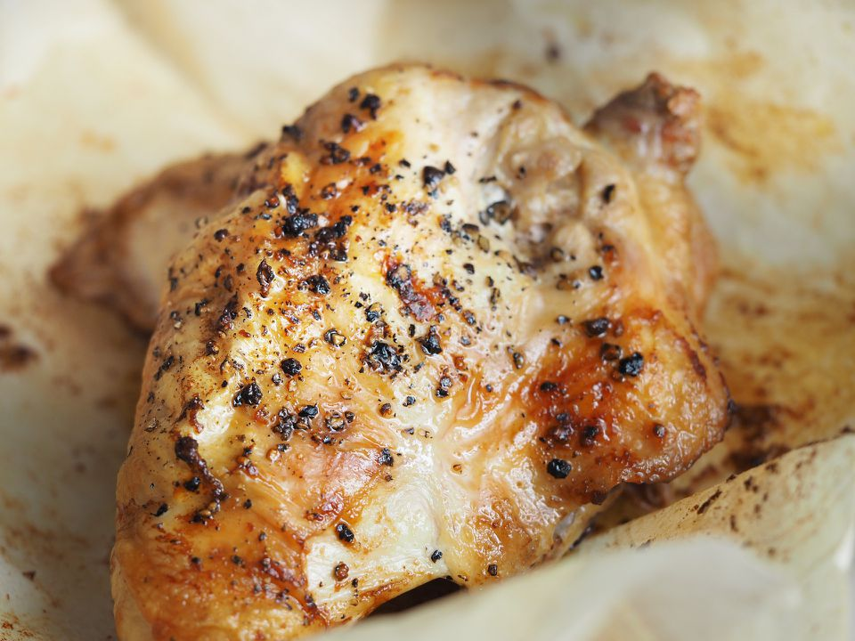 Roast chicken on parchment paper