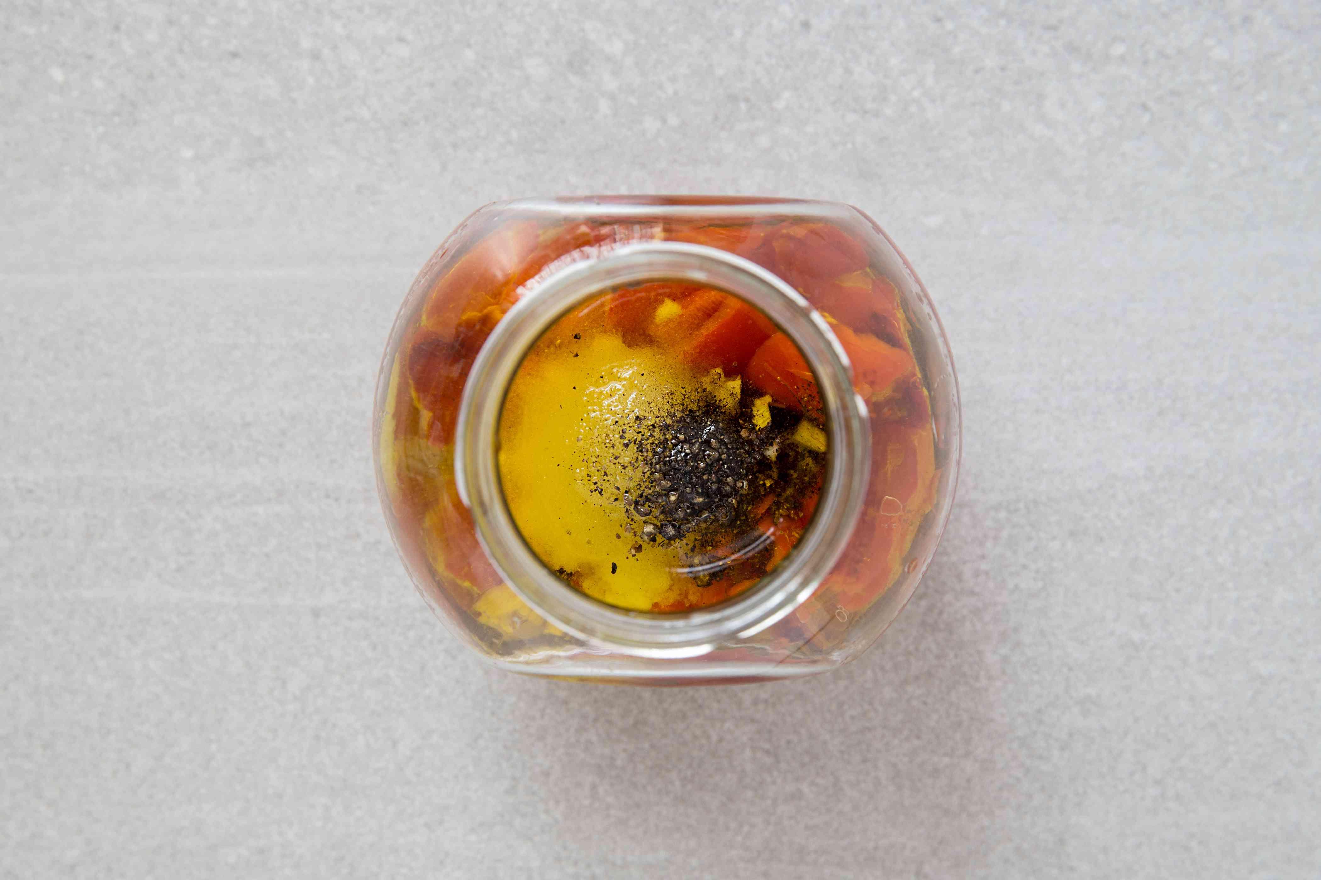 vinegar, oil, garlic, red pepper, salt, sugar, and black pepper in a jar