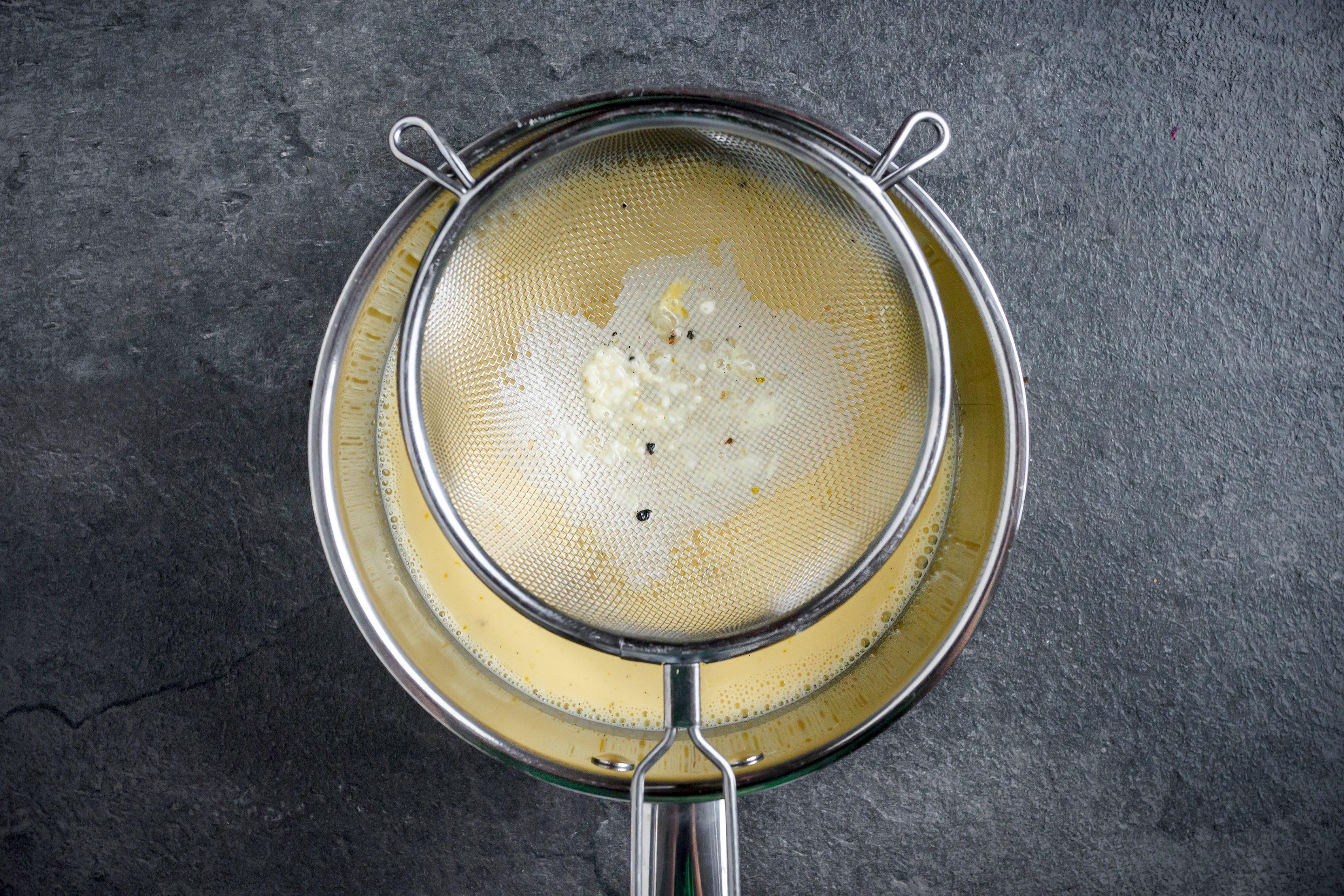 Straining custard mixture