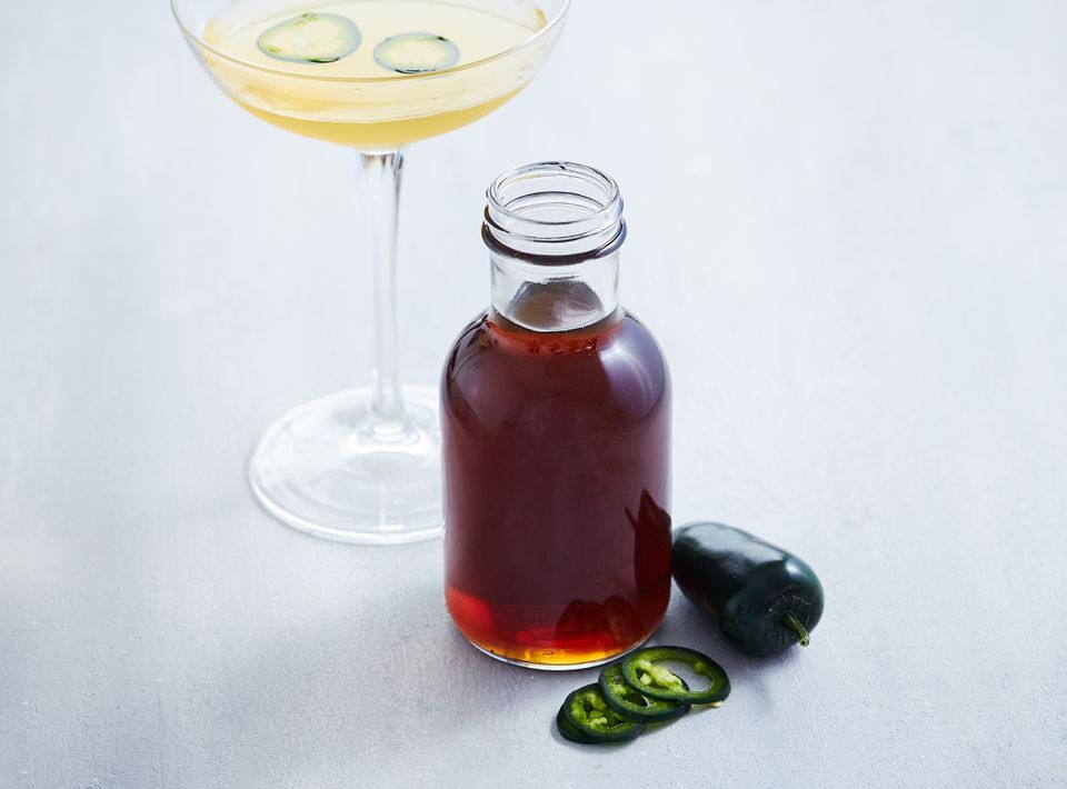 Homemade spicy jalapeño simple syrup in a glass bottle