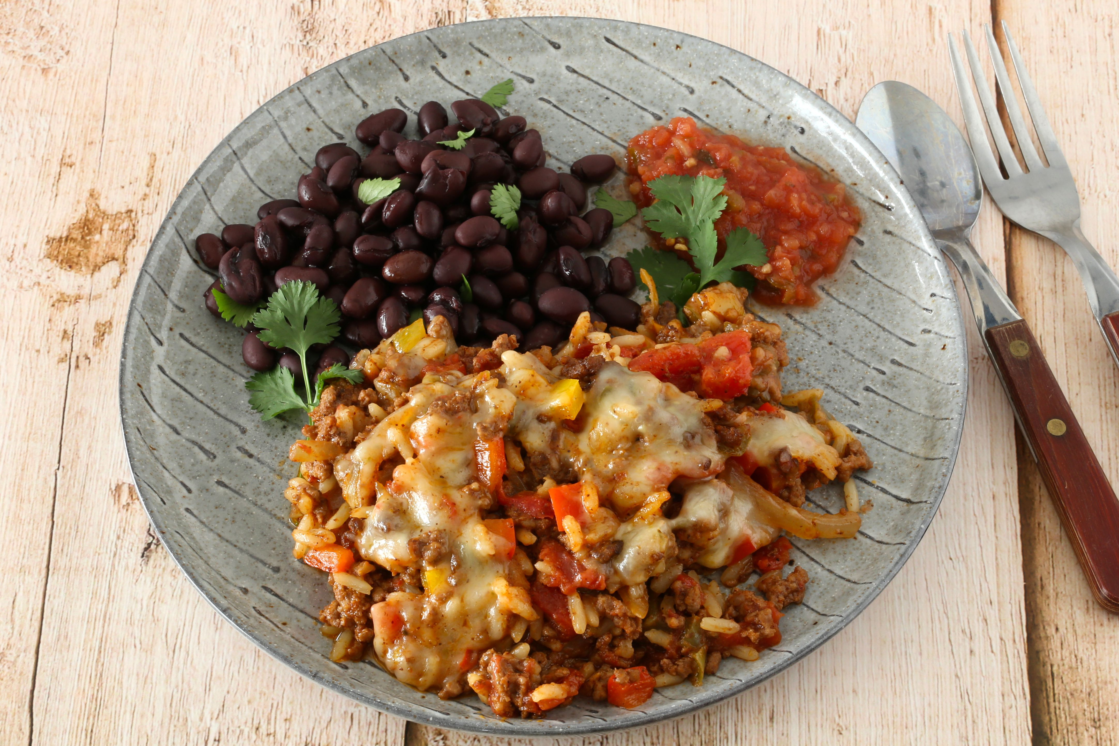 Plate with black beans and ground beef and rice casserole.