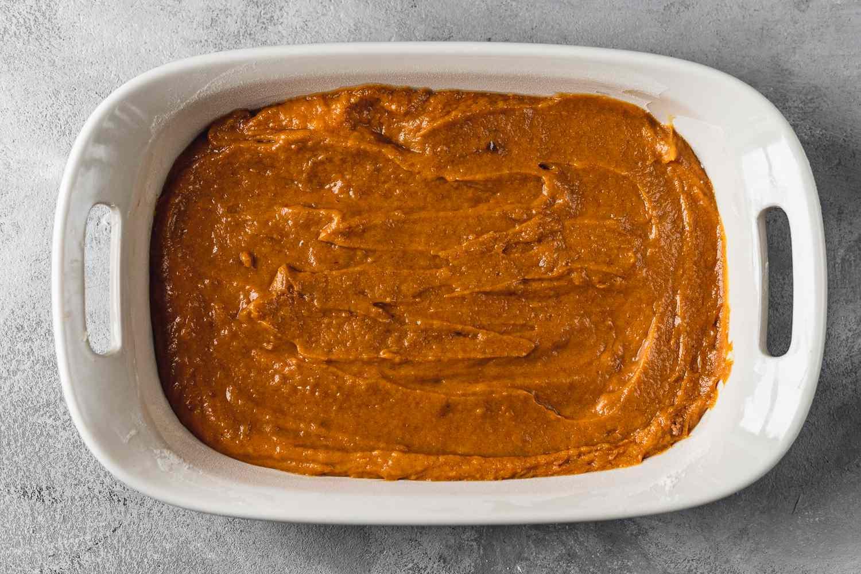pumpkin bars batter in a baking pan