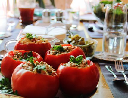 Stuffed Red Bell Peppers Served In Plate On Table