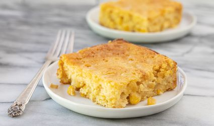 plates with cornbread casserole and fork