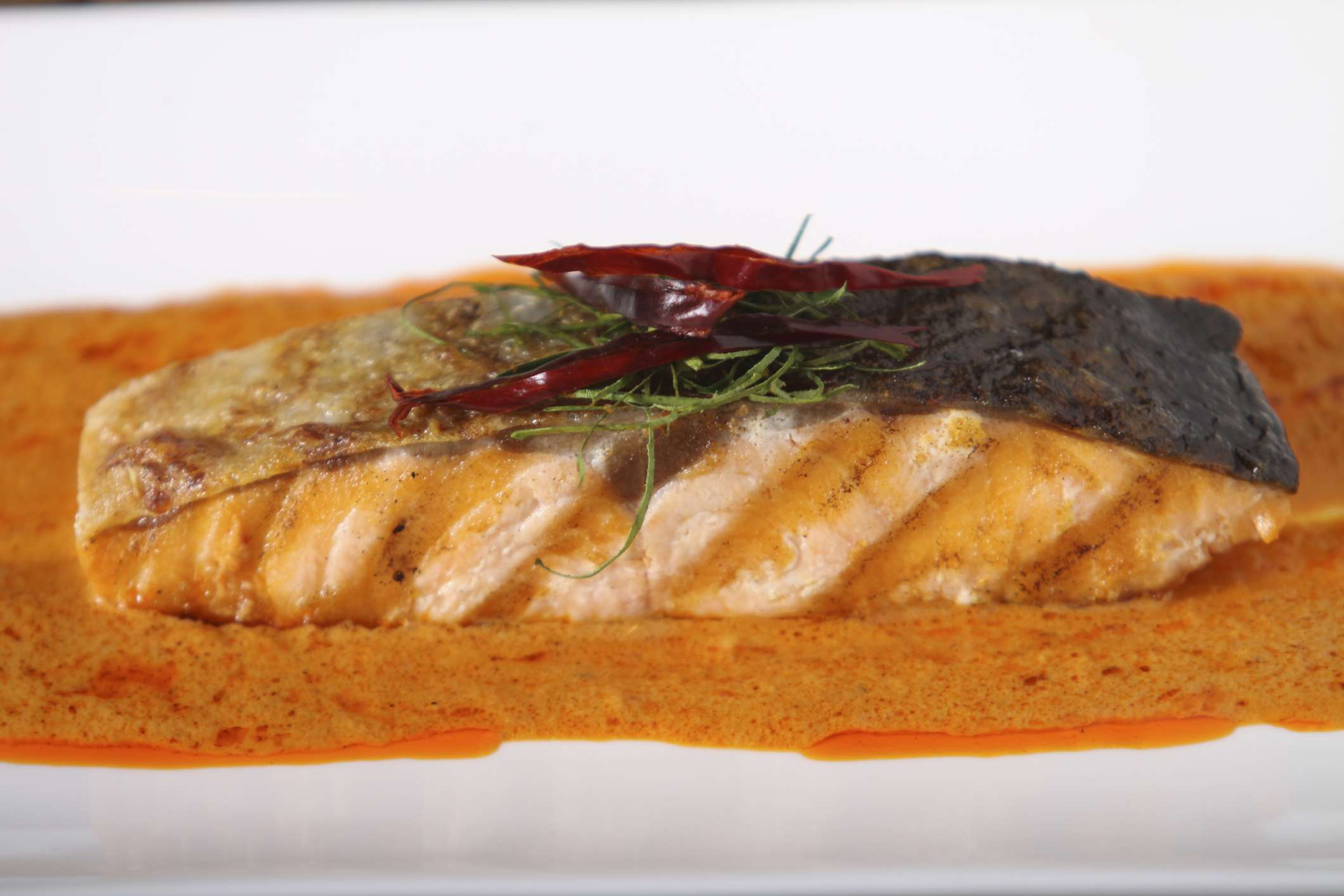 Salmon in a red curry sauce