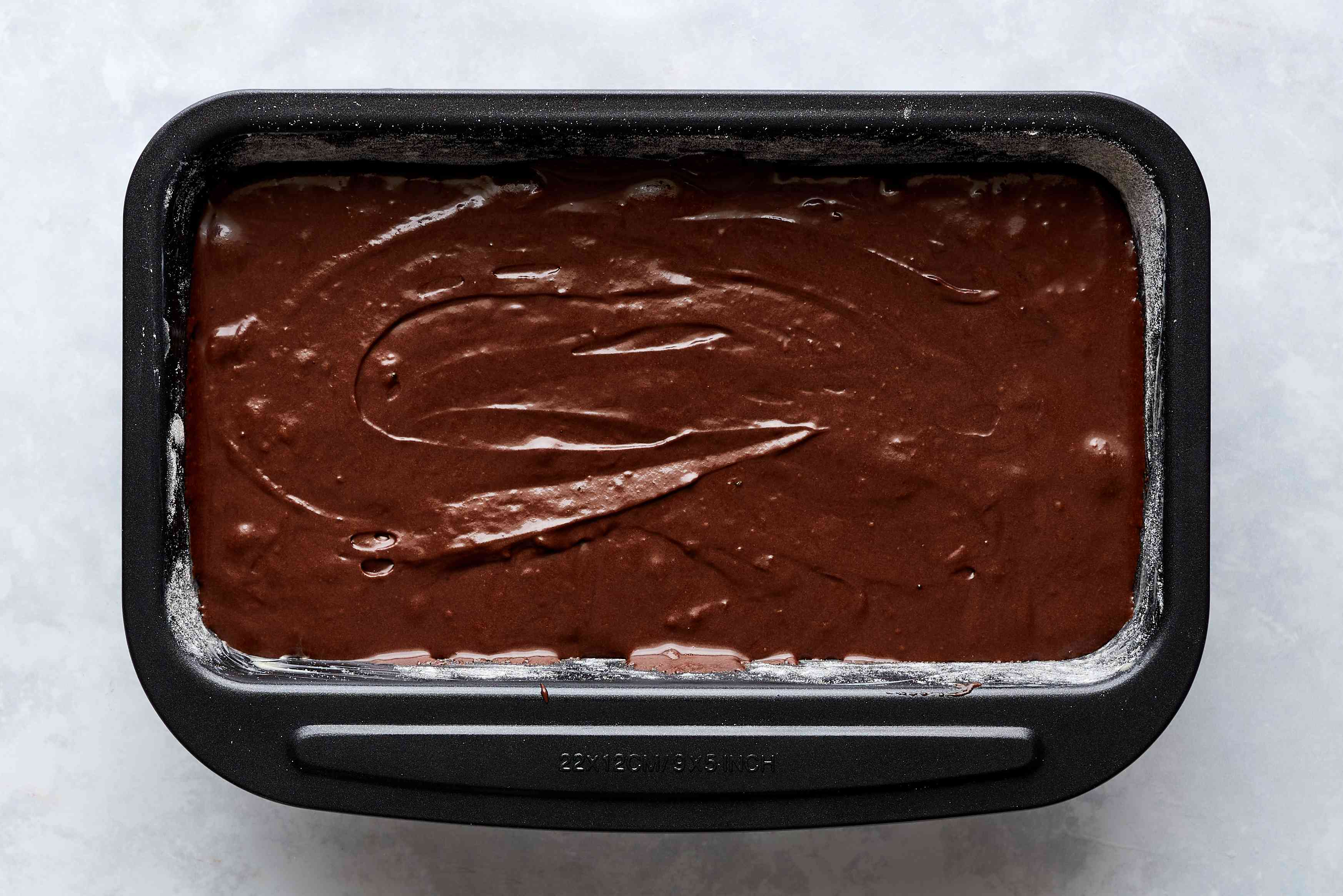 chocolate batter in a greased and floured baking pan