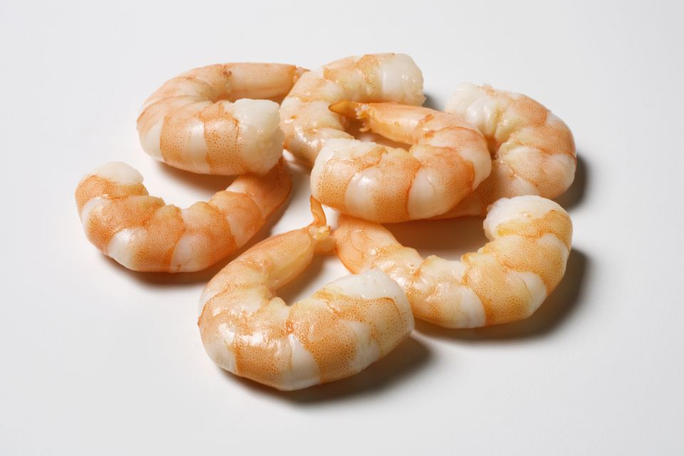 Several cooked shrimp, shells removed