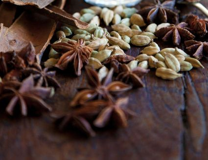 Chai spices on wooden table