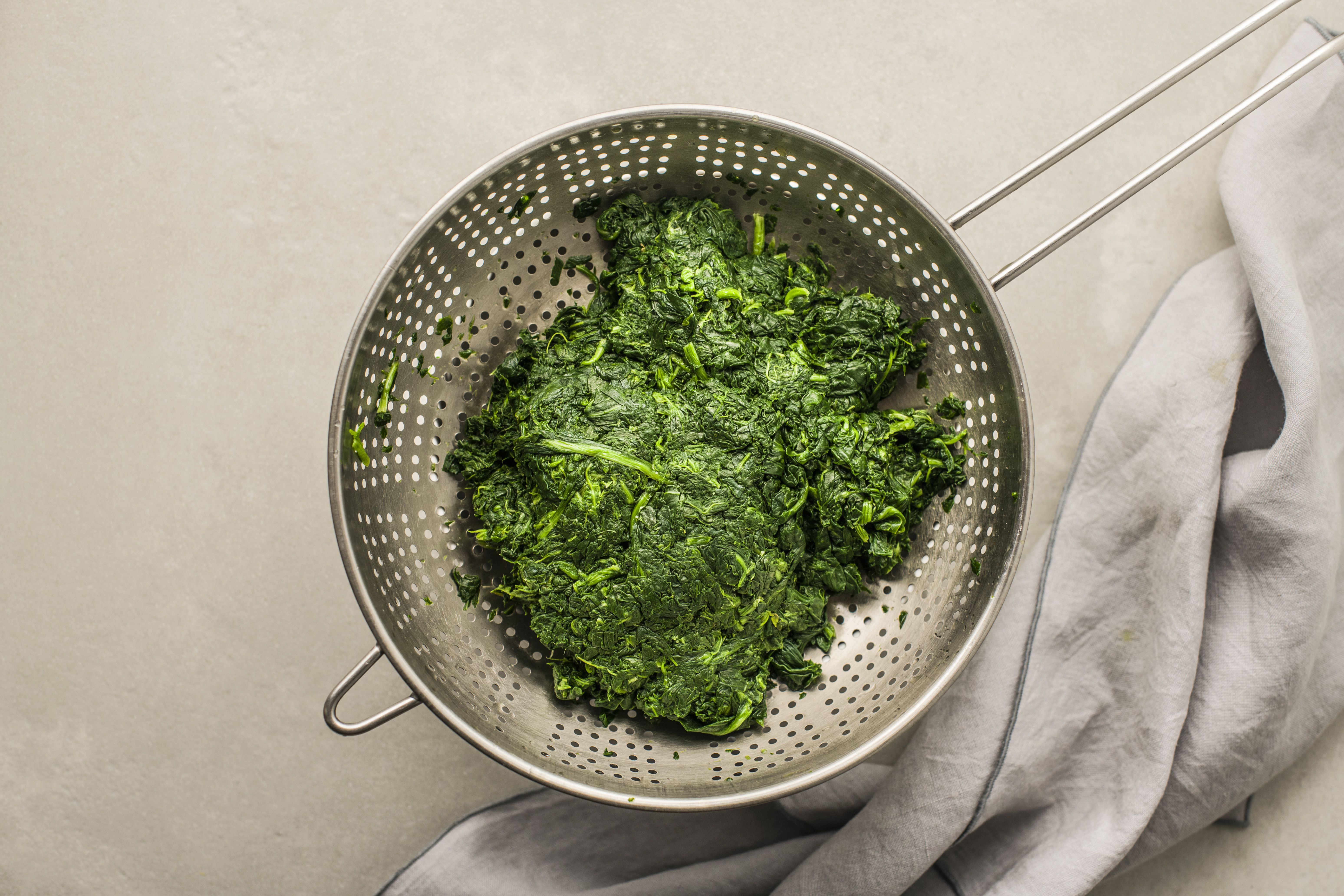 Thaw the spinach in a colander