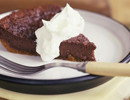 Fudge brownie pie with whipped topping