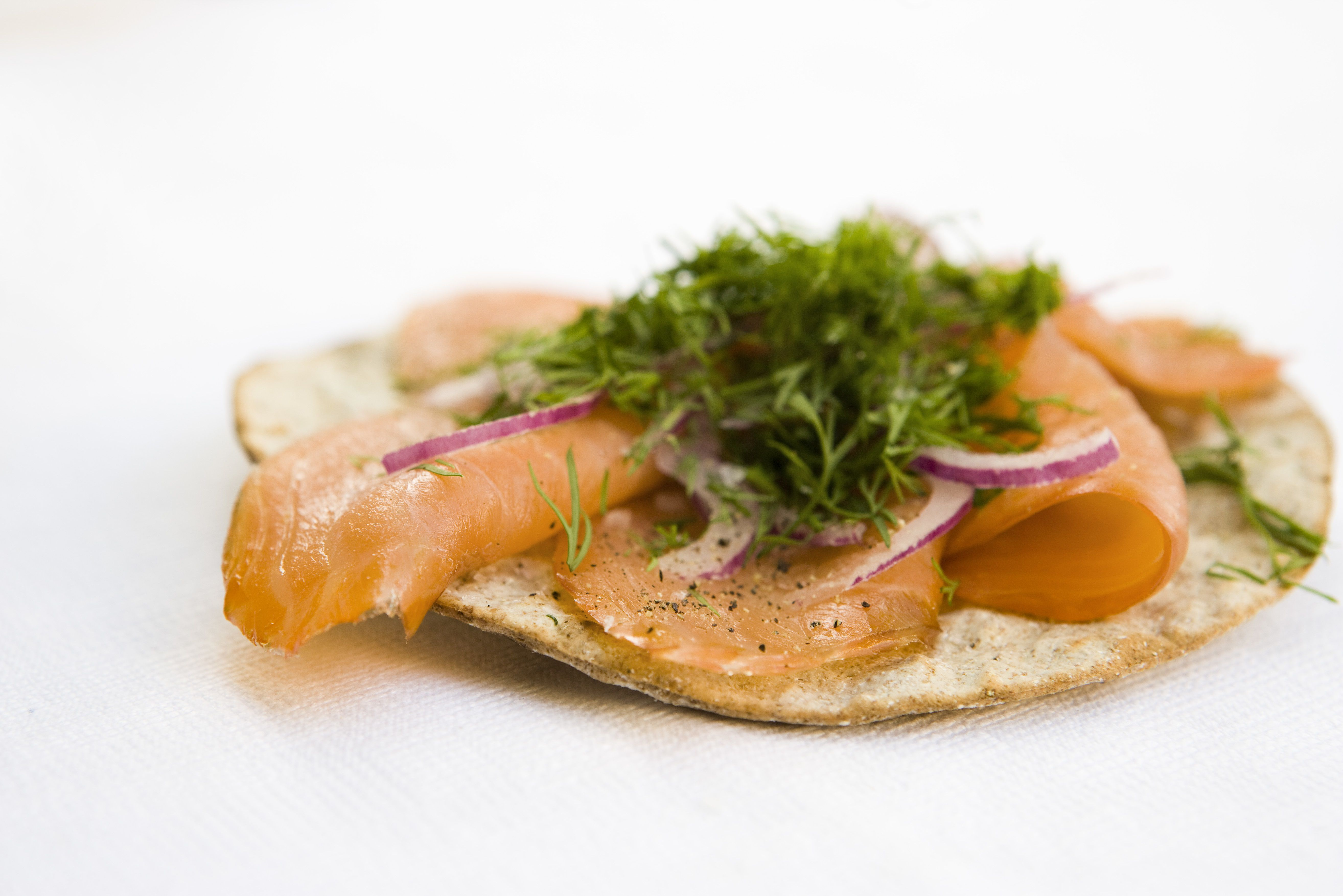 Crisp bread topped with smoked salmon and fresh dill