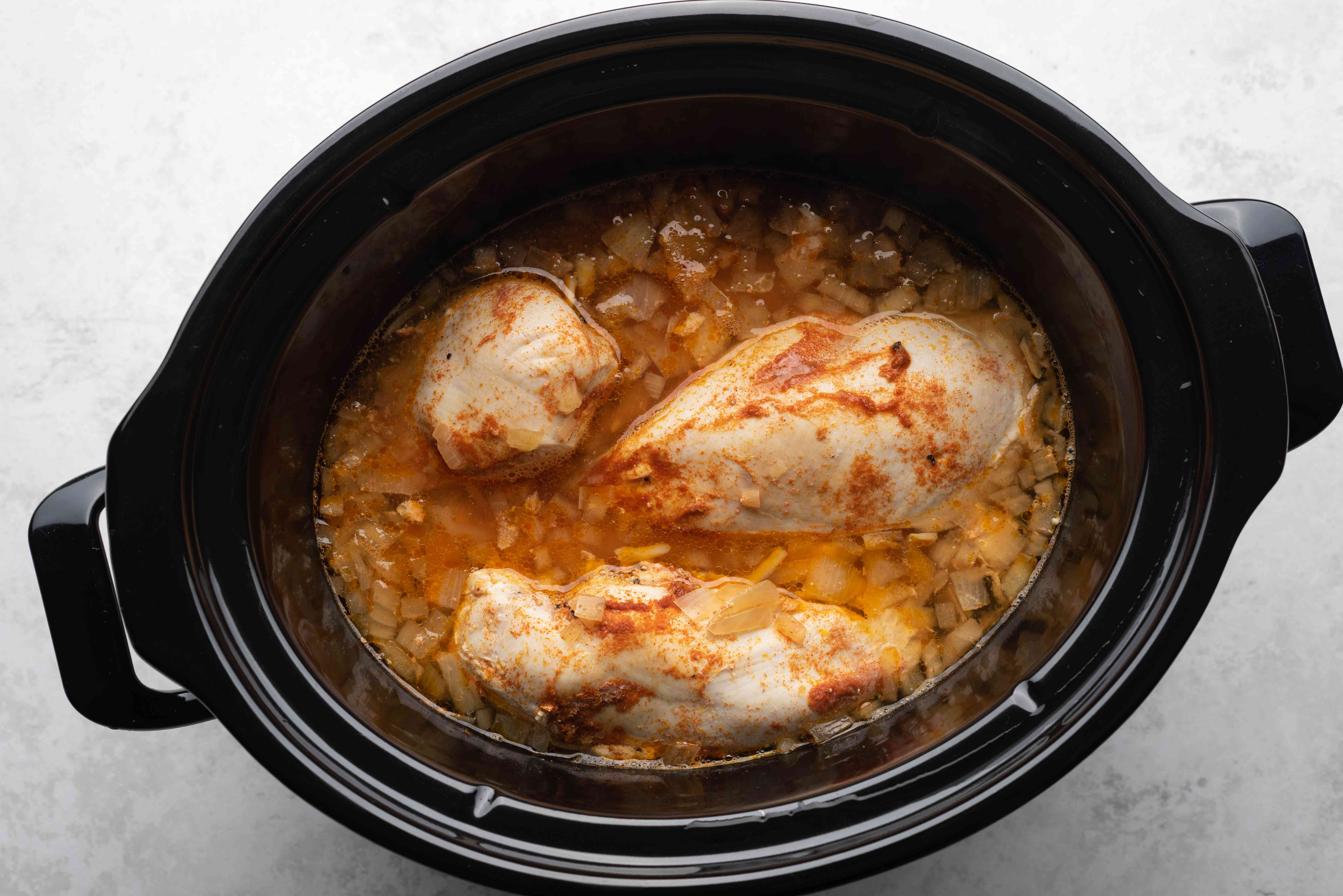 chicken cooking in a slow cooker