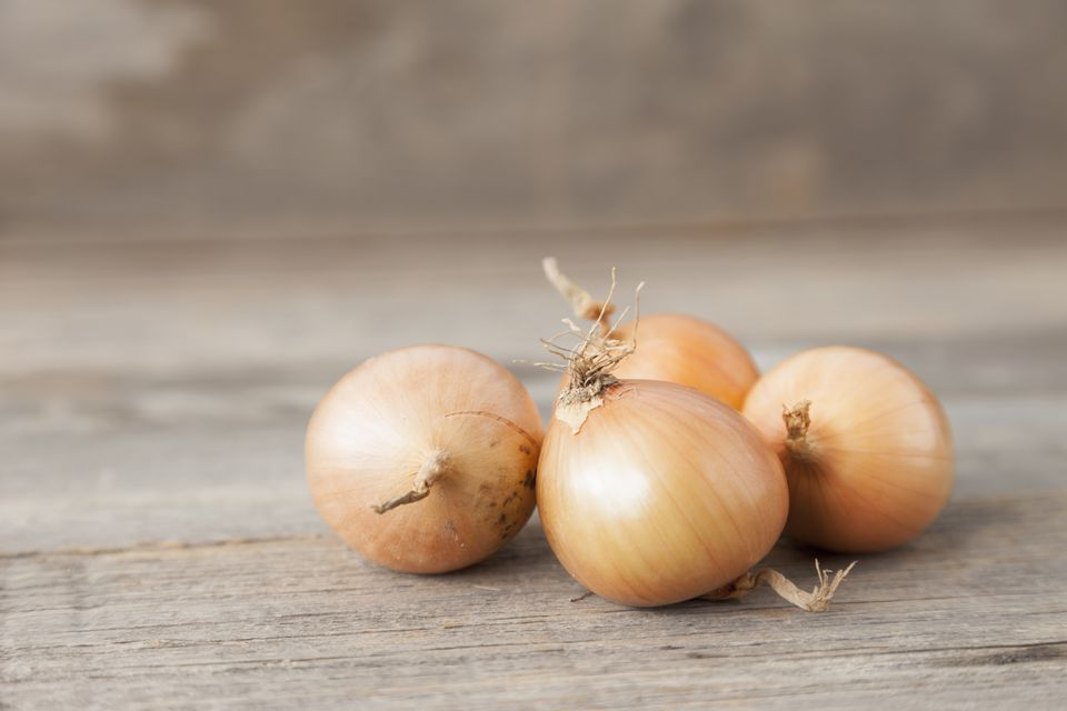 Close up of onions on table