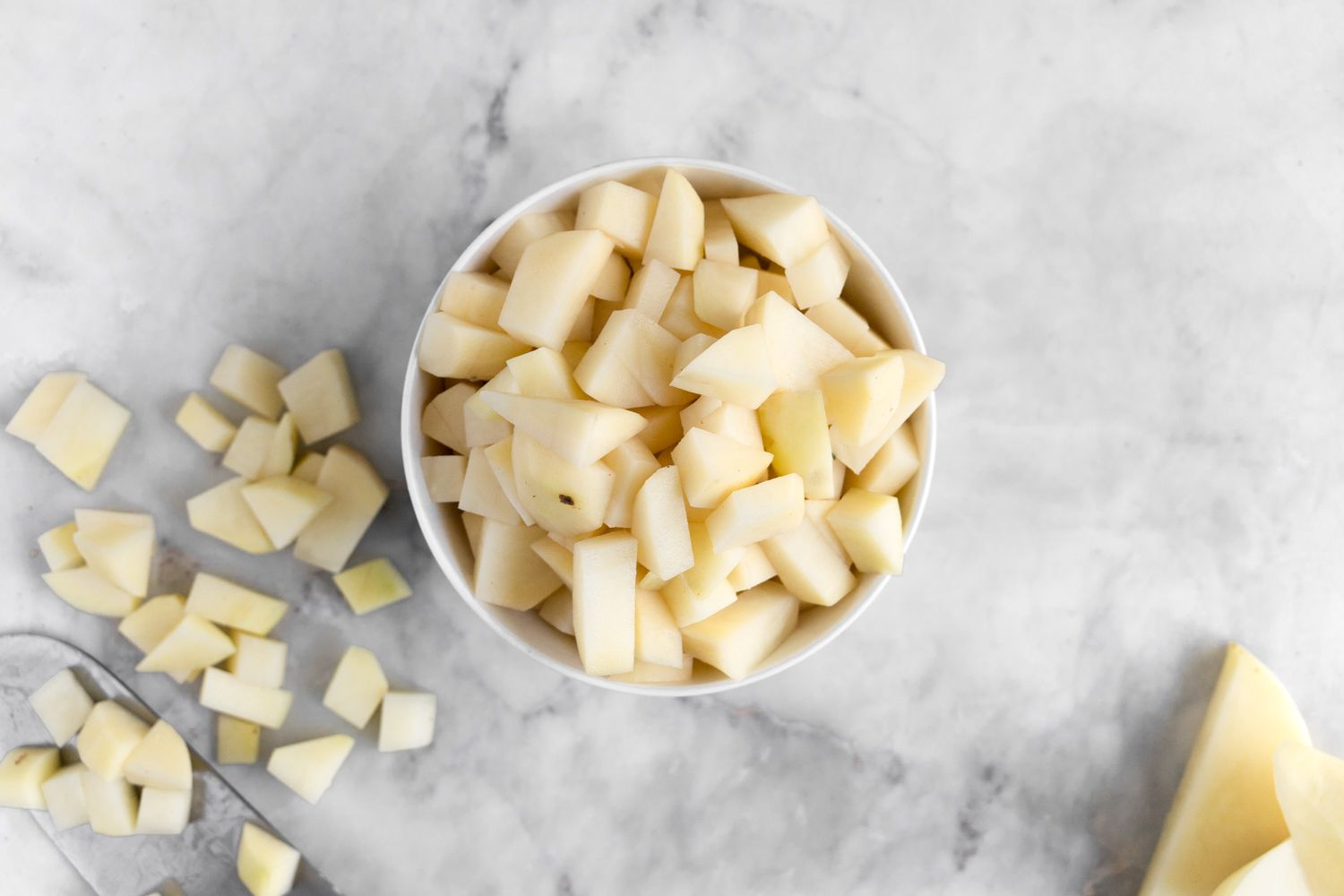 peeled and cubed potatoes in a bowl