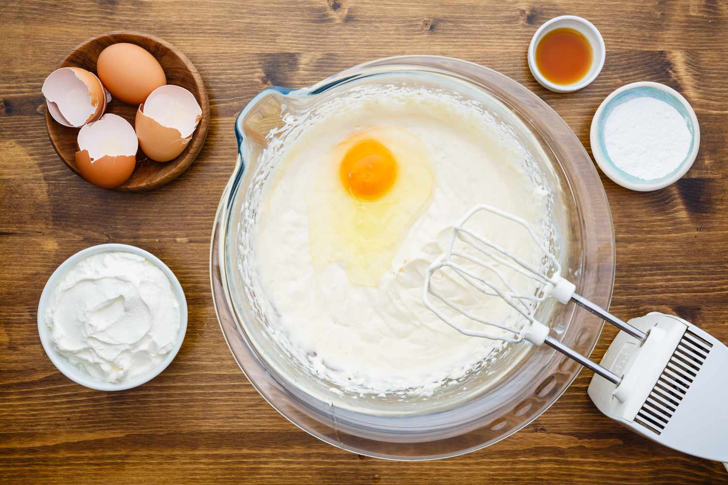 Add eggs to cheesecake batter