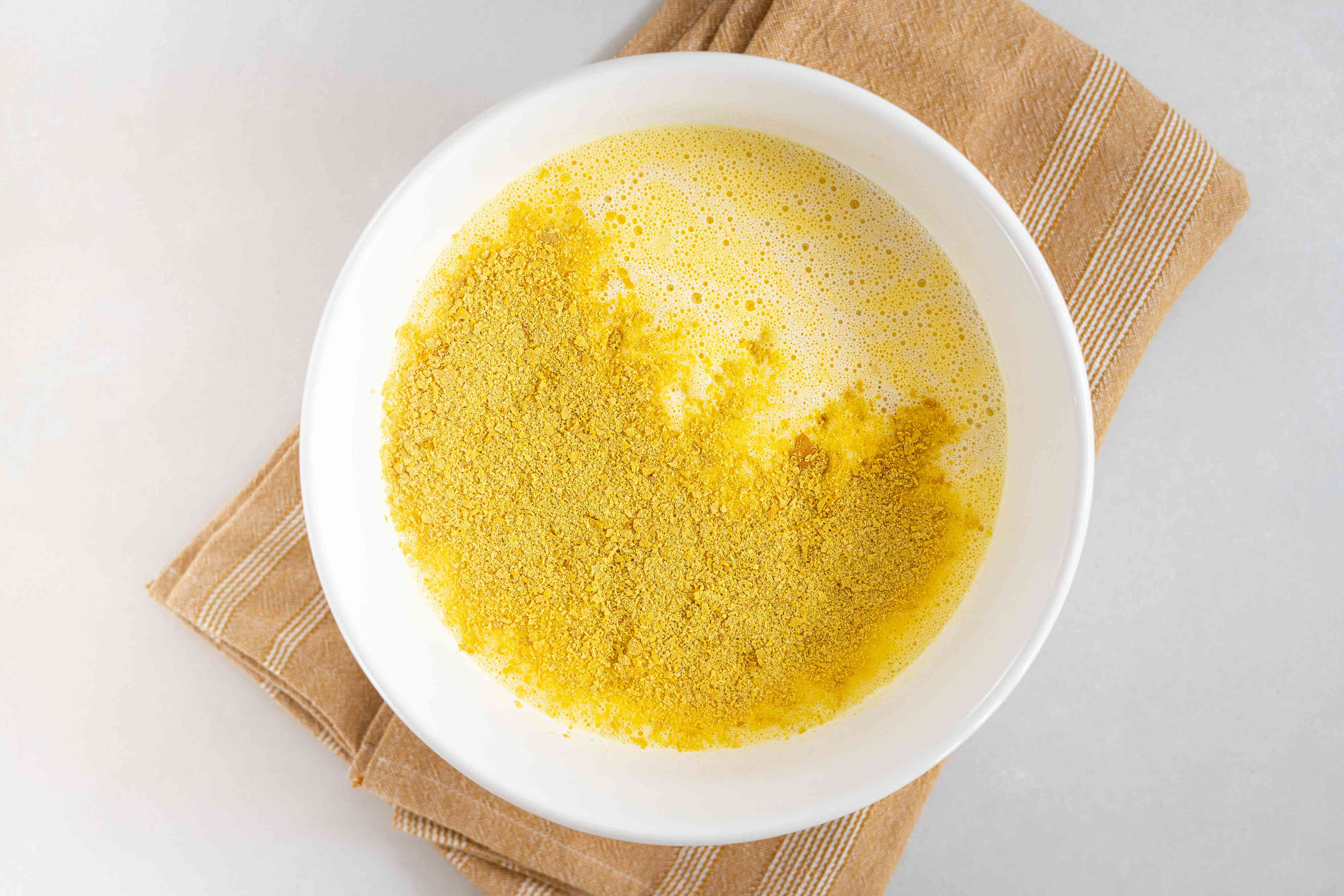 Gradually add the almond milk, nutritional yeast, and salt to the egg mixture