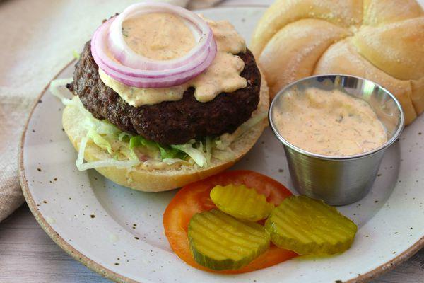 Cajun burger with remoulade sauce.