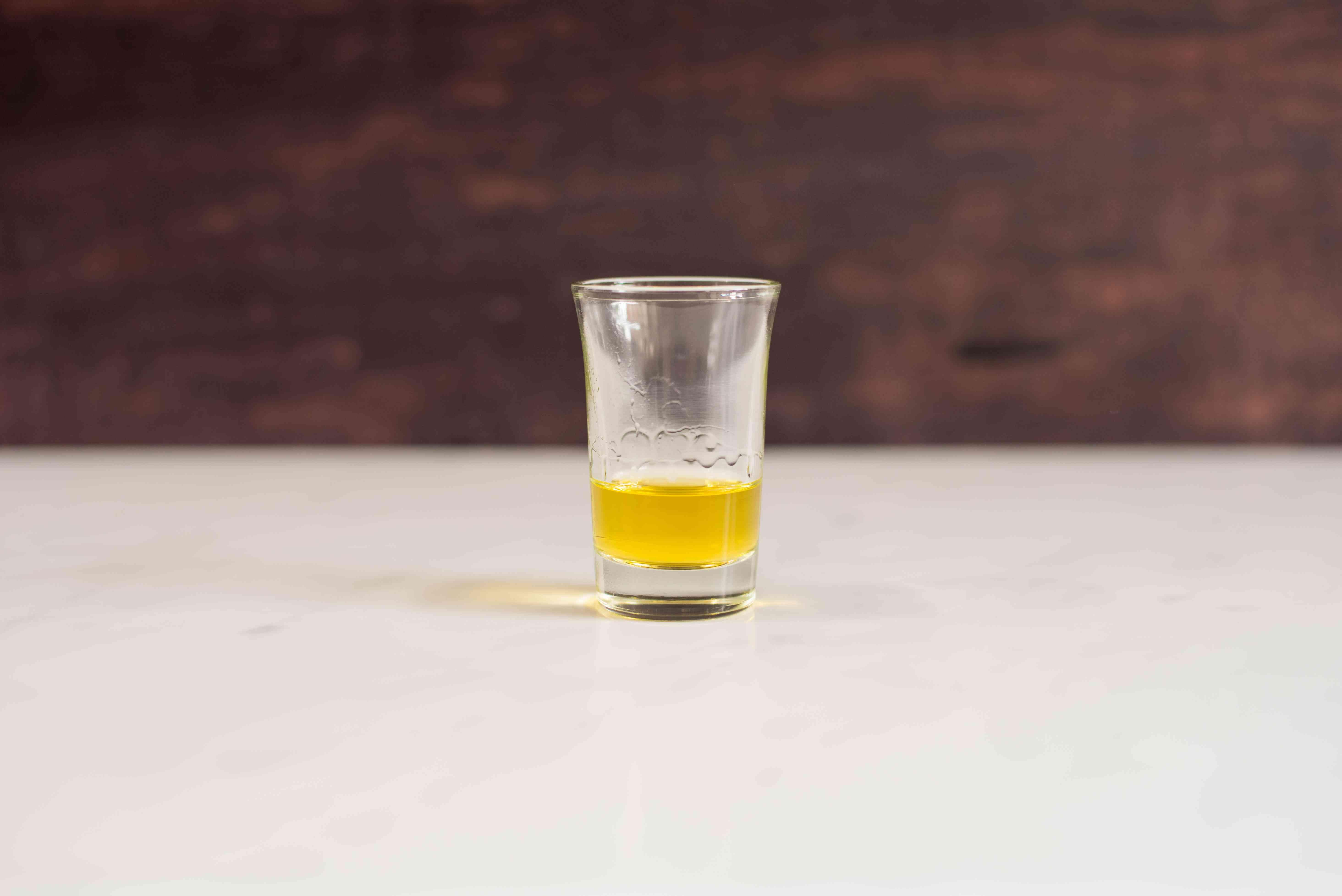 Pour Galliano in shot glass