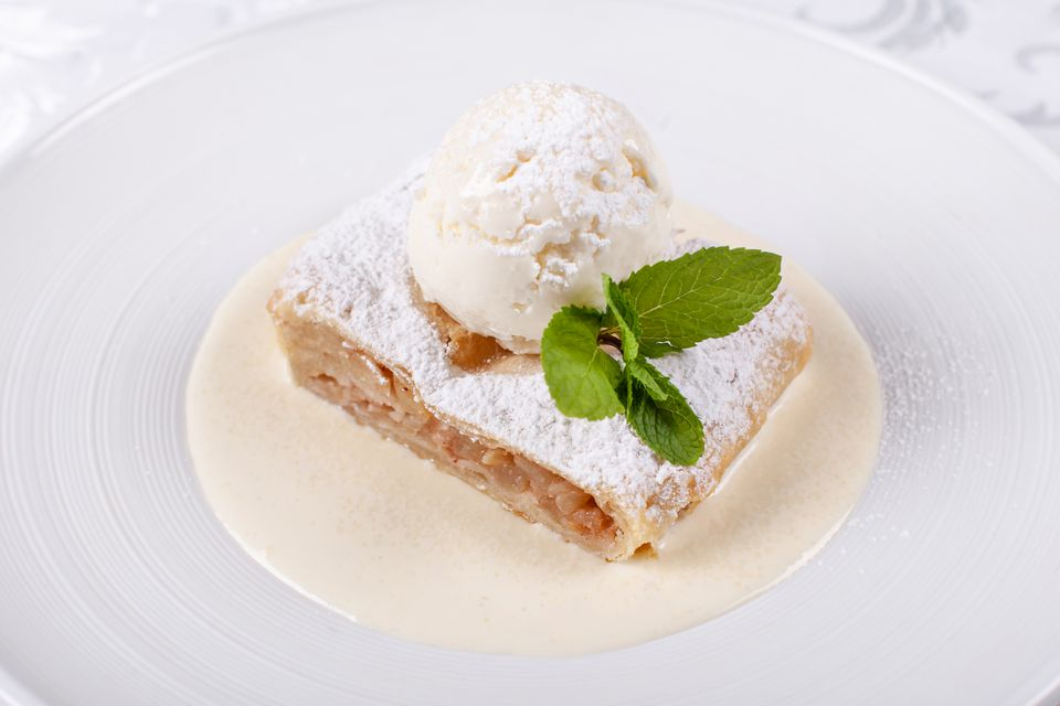 Apple strudel with ice cream and vanilla sauce