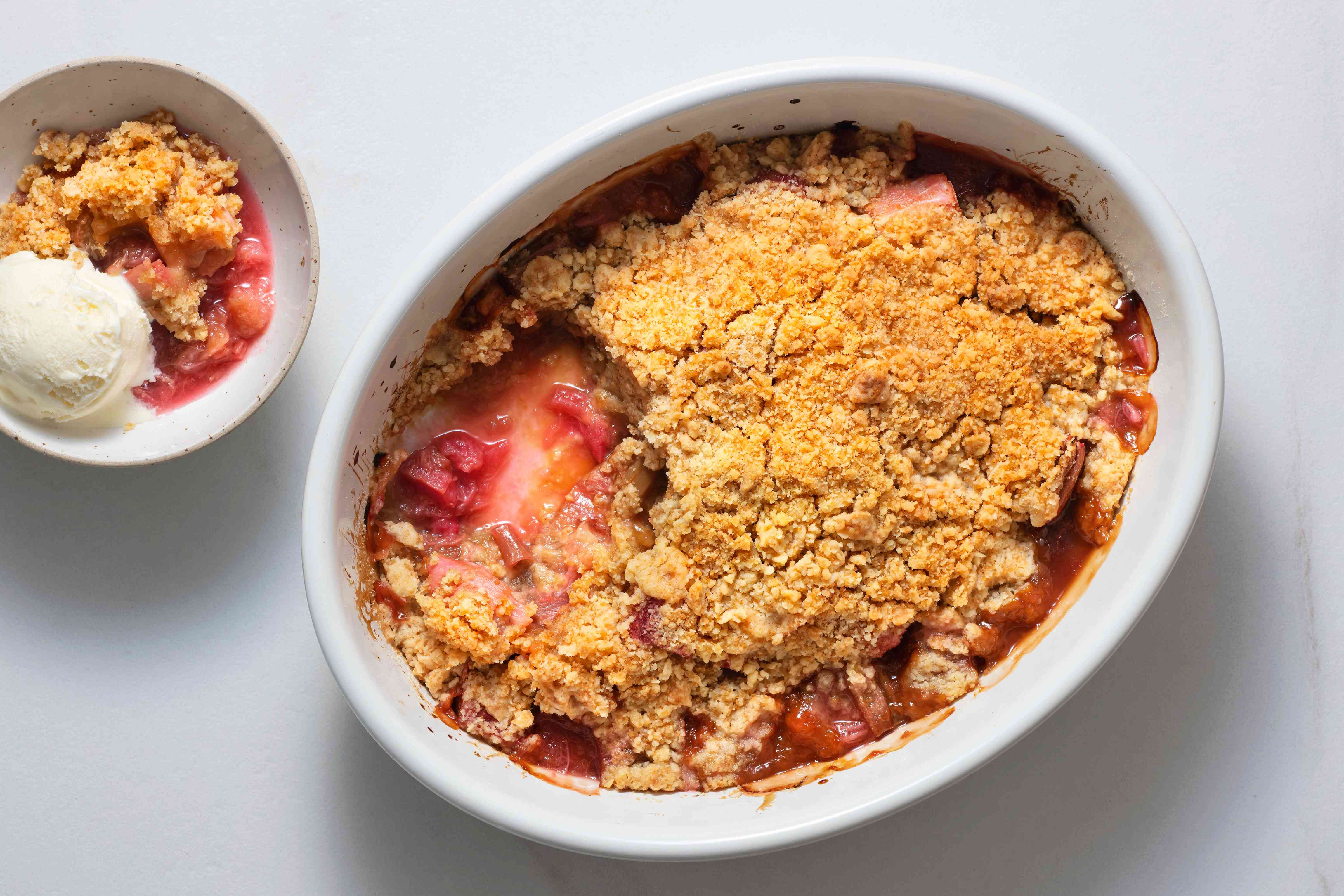Roasted Rhubarb and Vanilla Crumble in a baking dish and also in a bowl served with ice cream